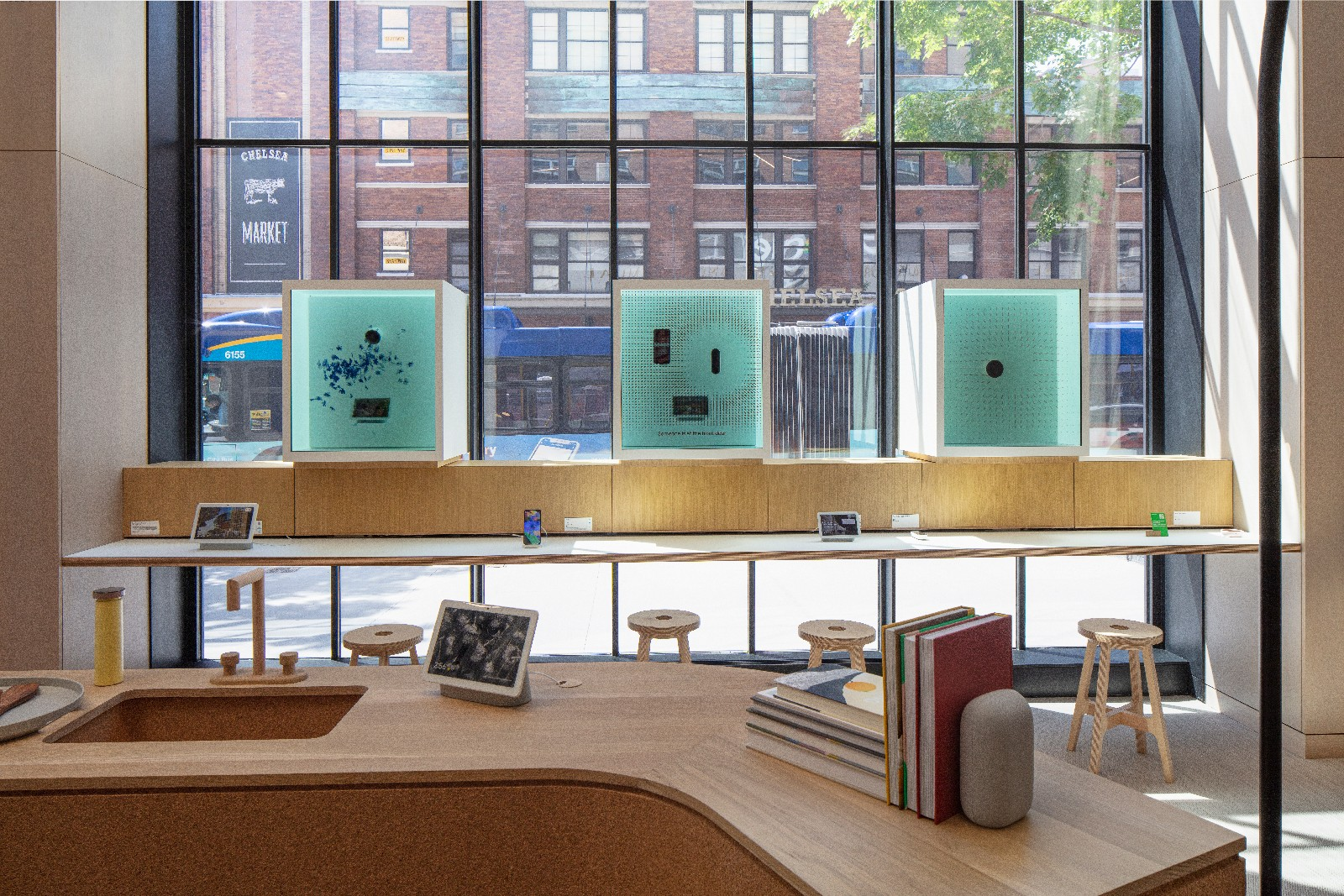 <p>Google Store Chelsea. Interior of the store with large windows and wooden furniture.</p>
