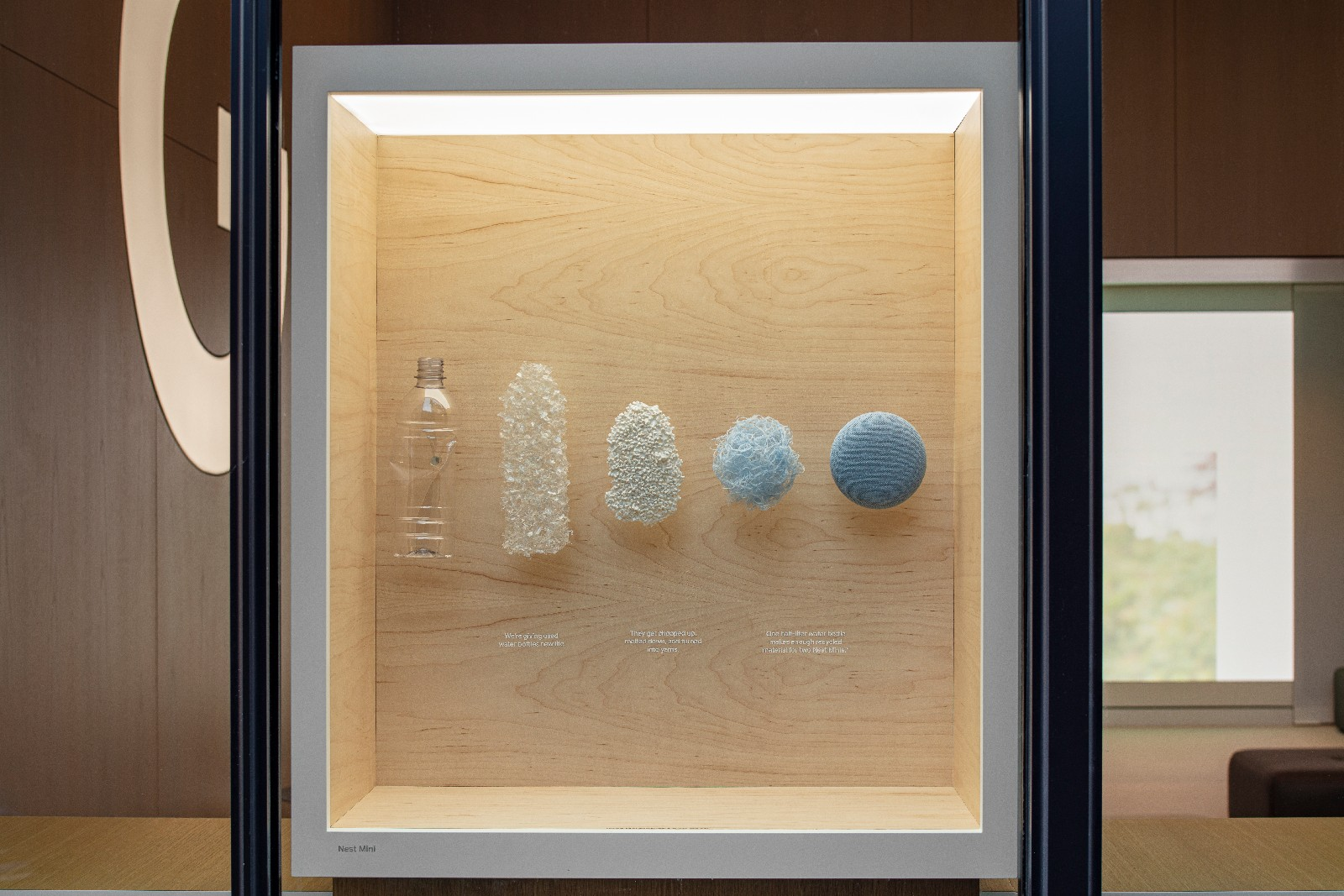<p>Google Store Chelsea. A Discovery box in the store showcasing Google products recycled plastic bottles that become the fabric covering for a Nest mini speaker.</p>