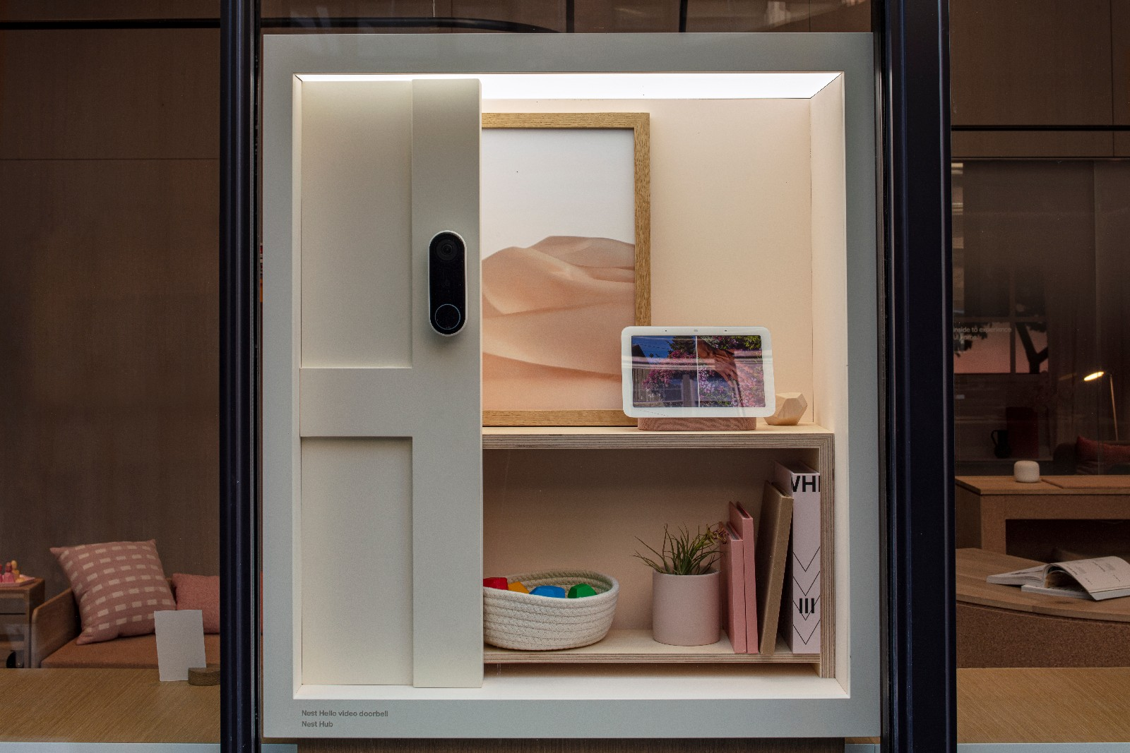 <p>Google Store Chelsea. A Discovery box in the store showcasing Google products like a smart display and Pixel phone.</p>