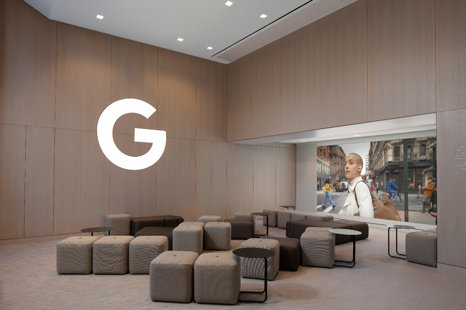 <p>Google Store Chelsea. The empty workshop area with ottomans and small tables.</p>