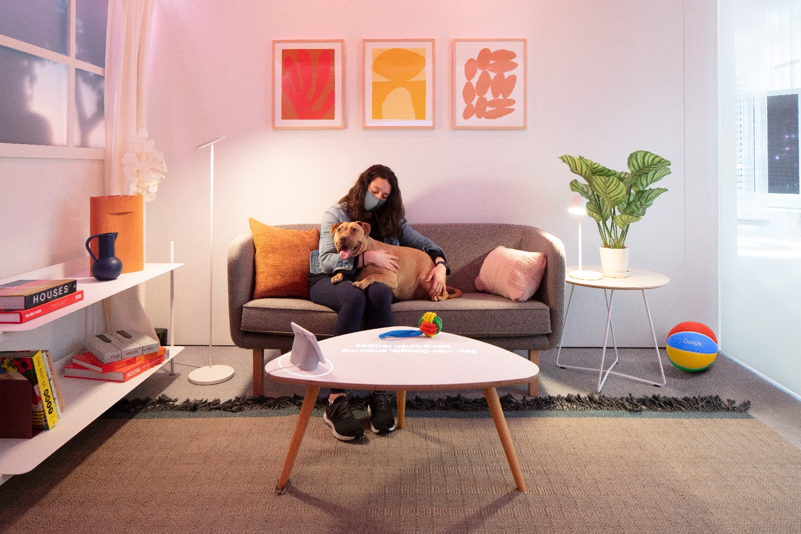<p>Google Store Chelsea. A Home-themed Sandbox featuring a couch, coffee table, shelves and plants. A Nest Hub smart display sits on the coffee table.</p>
