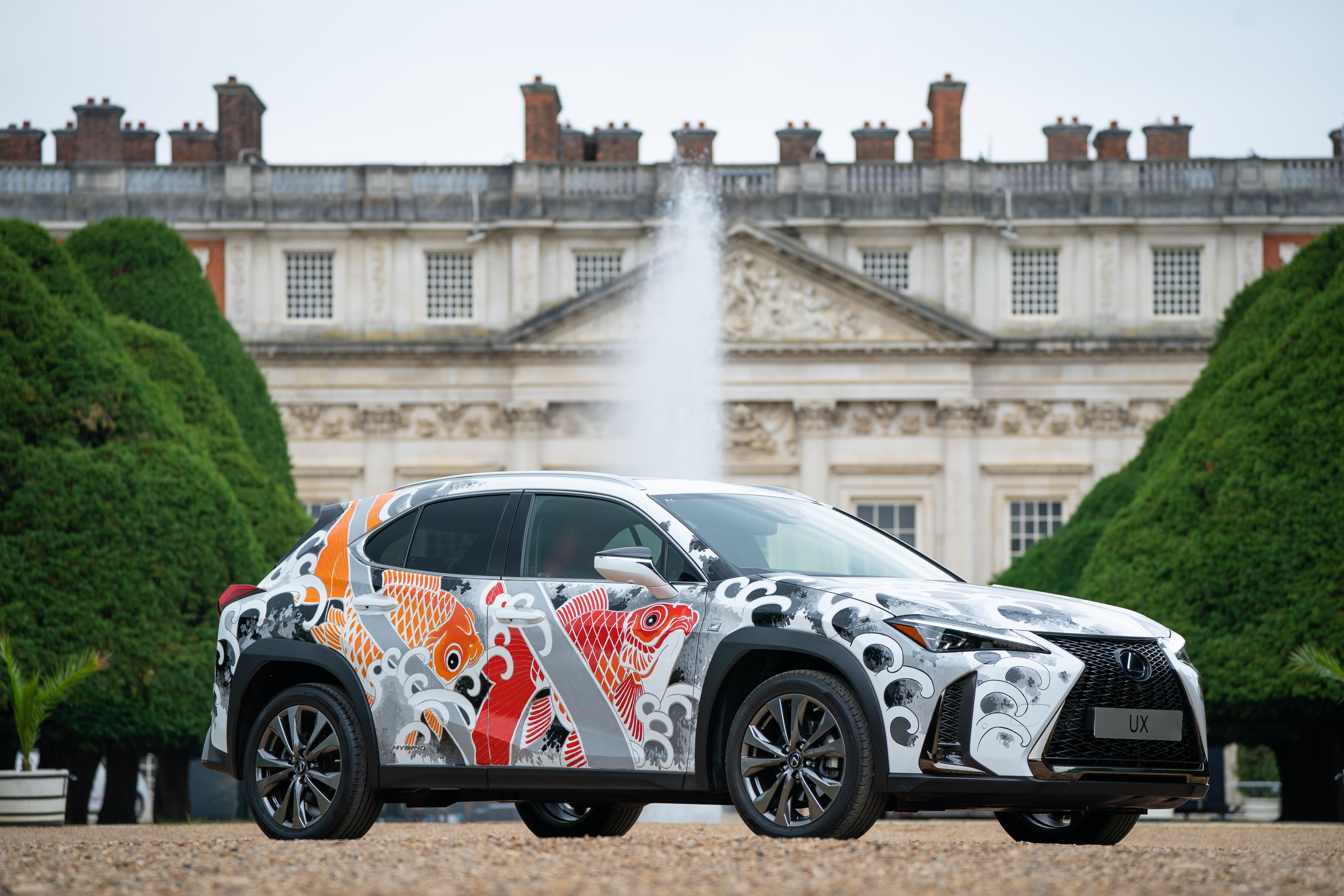 <p>The world's first tattoed car, a Lexus UX compact SUV, in the East Garden at Hampton Court Palace, south west London, ahead of the Hampton Court Palace Artisan Fair which begins on Friday. Artist Claudia De Sabe will tattoo the UX bonnet with 3 bespoke designs each day. Picture date: Thursday June 17, 2021.</p>
