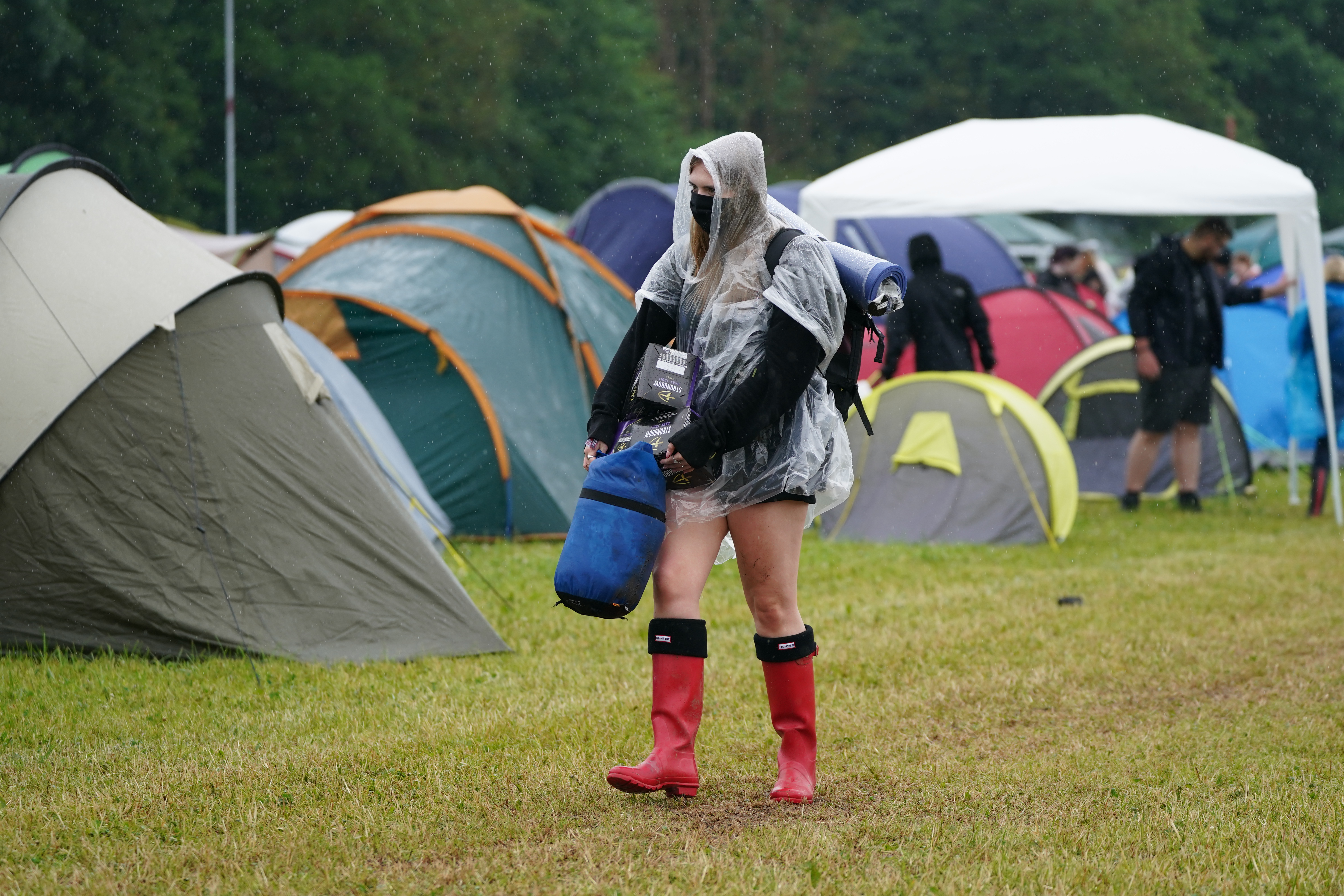 <p>A festivalgoer arrives on the first day of Download Festival at Donington Park in Leicestershire. Picture date: Friday June 18, 2021.</p>