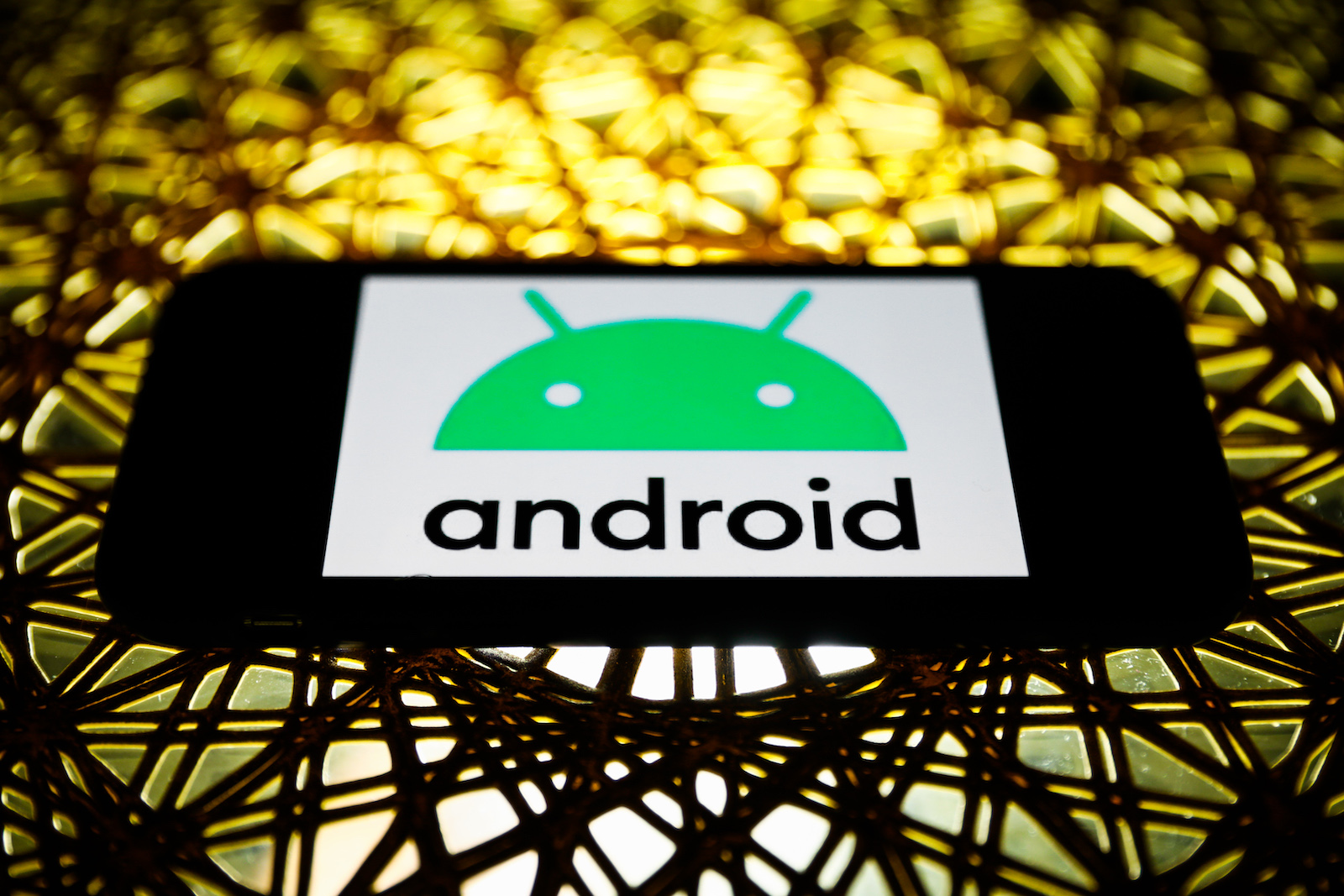Android logo is seen displayed on a phone screen in this illustration photo taken in Poland on November 30, 2020. (Photo by Jakub Porzycki/NurPhoto via Getty Images)