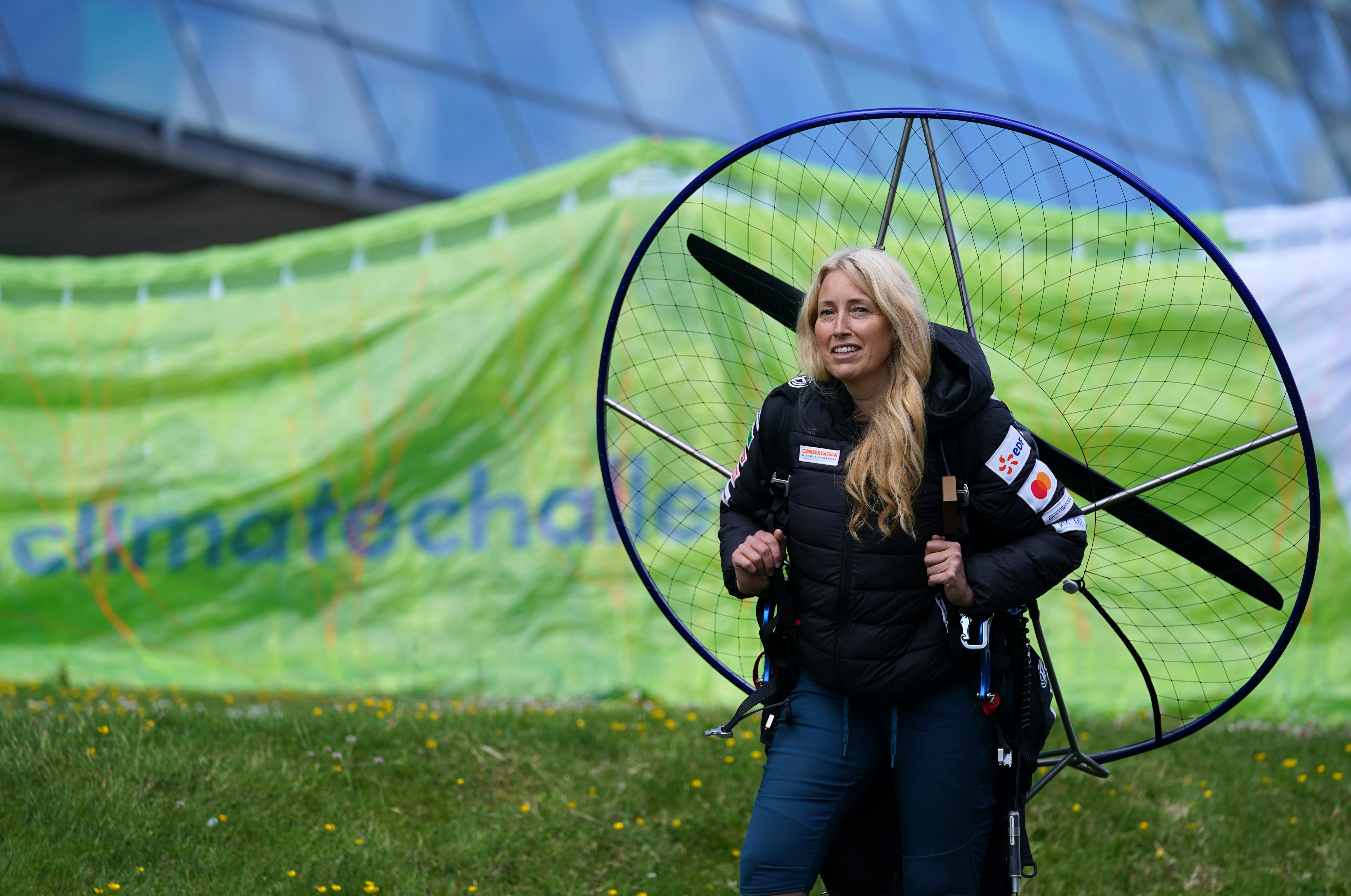 <p>Paramotorist Sacha Dench with her adapted electric paramotor at Glasgow Science Centre. Sacha, who is known as the 'Human Swan', will circumnavigate Britain in the adapted electric paramotor, flying anti-clockwise around the coast and returning to land in Glasgow around six weeks later, to mark the Cop26 climate conference being held in Glasgow. Picture date: Friday June 18, 2021.</p>