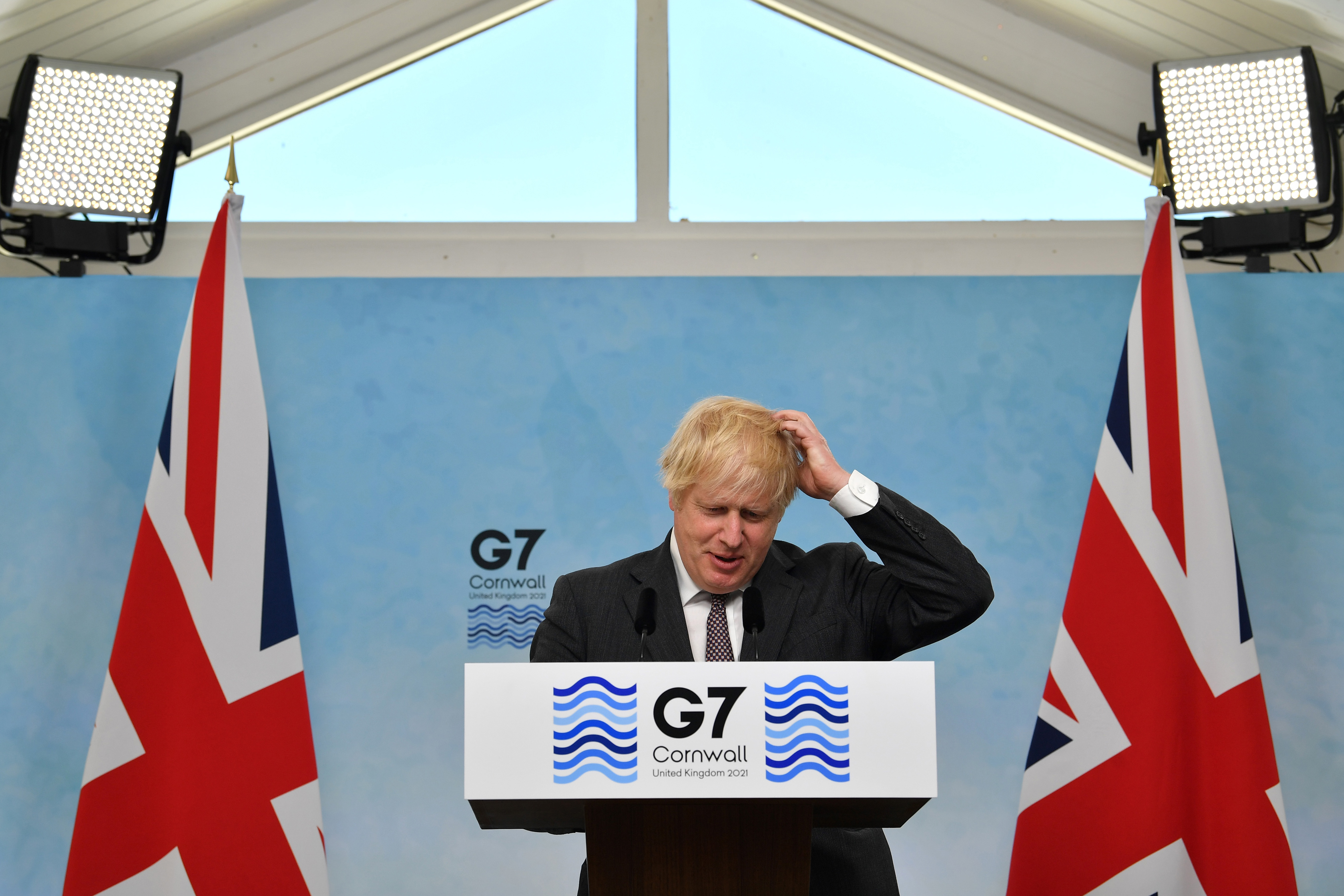 <p>CARBIS BAY, CORNWALL - JUNE 13:  British Prime Minister Boris Johnson takes part in a press conference on the final day of the G7 summit in Carbis Bay on June 13, 2021 in Cornwall, United Kingdom. UK Prime Minister, Boris Johnson, hosts leaders from the USA, Japan, Germany, France, Italy and Canada at the G7 Summit. This year the UK has invited India, South Africa, and South Korea to attend the Leaders' Summit as guest countries as well as the EU. (Photo by Ben Stansall - WPA Pool/Getty Images)</p>