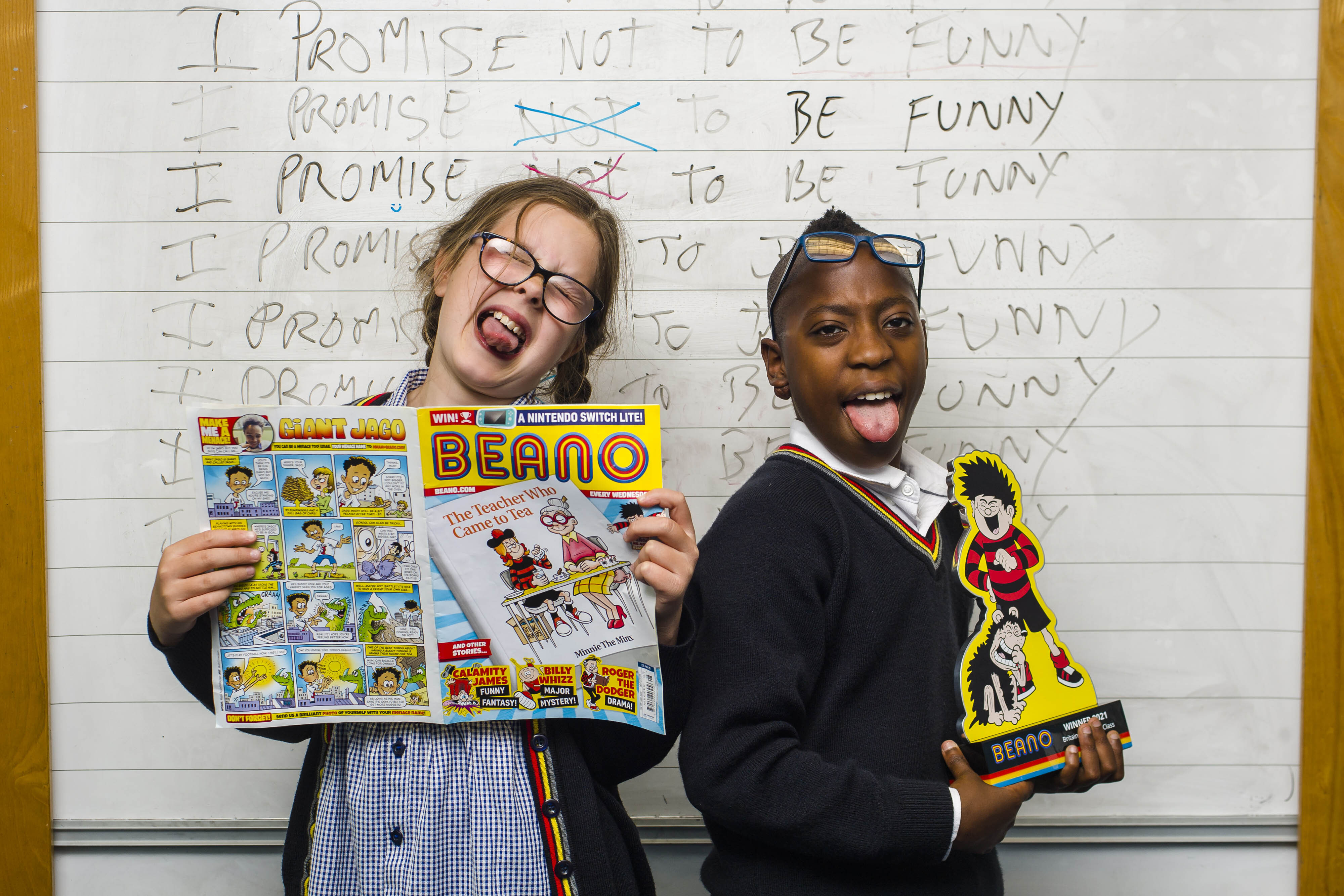 <p>Pupils (left to right) Mia Smith and Vuyo Mdlalose from class 5B at Forthill Primary school in Dundee with the trophy, as their class is unveiled as this year�s winners of Beano's 'Britain's Funniest Class' national joke competition. Issue date: Thursday July 15, 2021.</p>