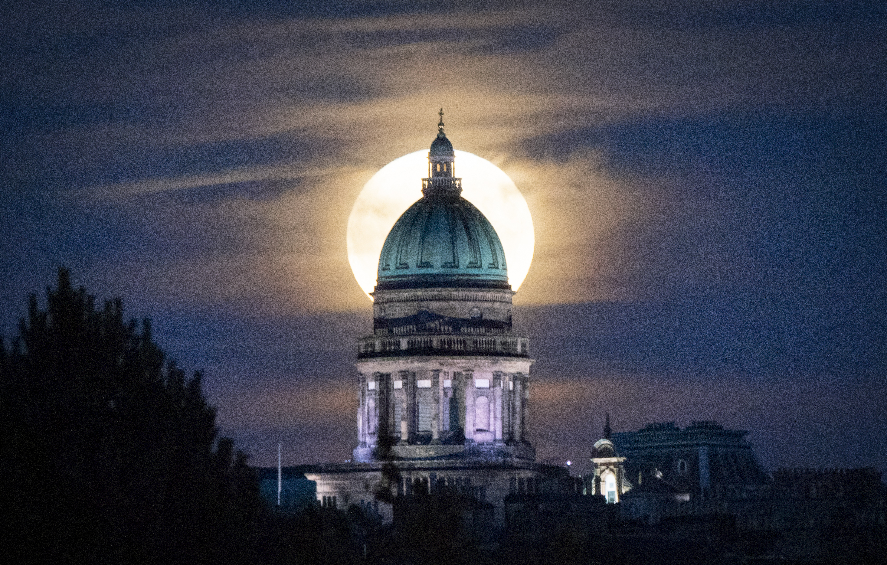 <p>The full moon rises behind West Register House in Edinburgh�s Charlotte Square. The July full moon, otherwise known as the Thunder Moon, is synonymous with summer storms. Picture date: Friday July 23, 2021.</p>