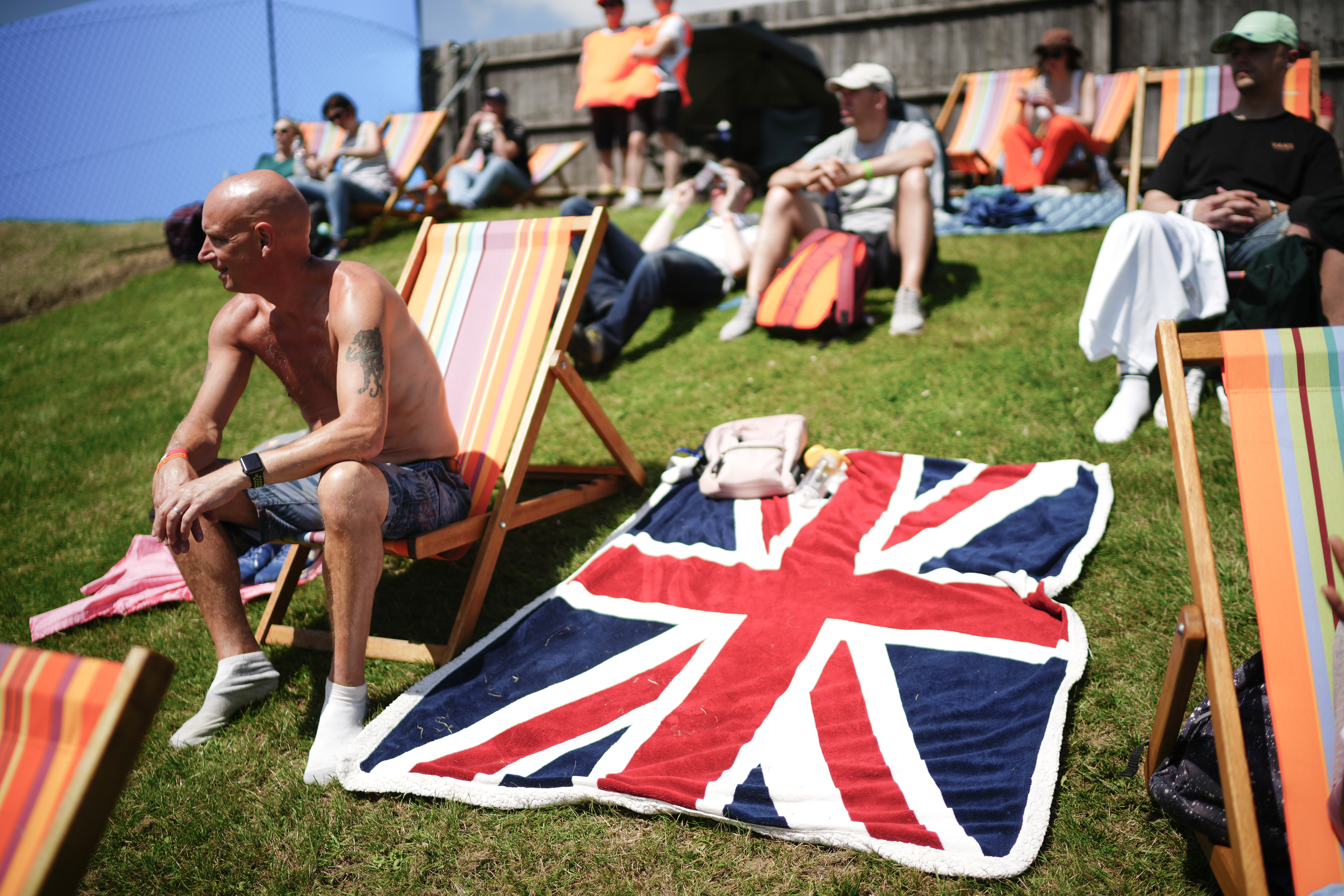 <p>NORTHAMPTON, ENGLAND - JULY 16: Motor racing fans soak up the atmosphere ahead of the  F1 Grand Prix of Great Britain at Silverstone Circuit on July 16, 2021 in Northampton, England. More than 140,000 are expected at this weekend's event, one of the largest sporting crowds since the start of the Covid-19 pandemic, which kept fans away from last year's Grand Prix. Ticket-holders aged 11 and up are required to show a negative lateral flow test or proof of full vaccination to attend the race. (Photo by Christopher Furlong/Getty Images)</p>