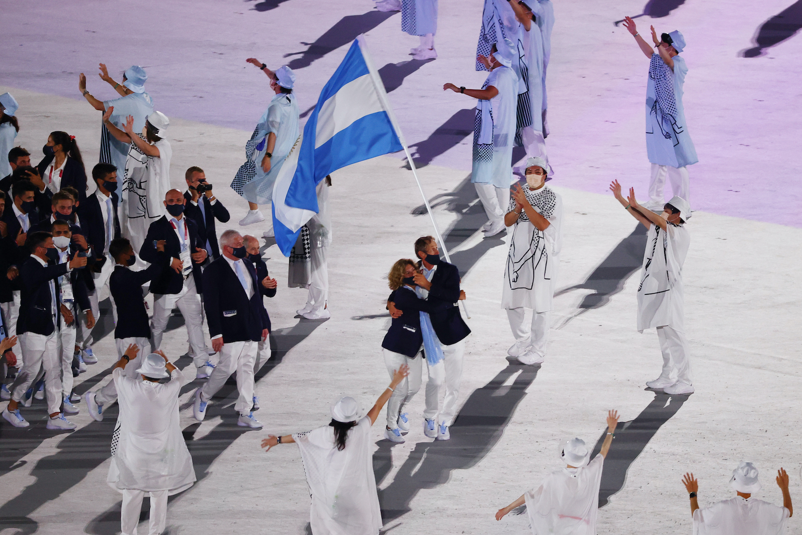 Tokyo 2020 Olympics - The Tokyo 2020 Olympics Opening Ceremony - Olympic Stadium, Tokyo, Japan - July 23, 2021.  Cecilia Carranza of Argentina and Santiago Lange of Argentina lead their contingent in the athletes parade during the opening ceremony REUTERS/Pilar Olivares - SP1EH7N0XQDPC