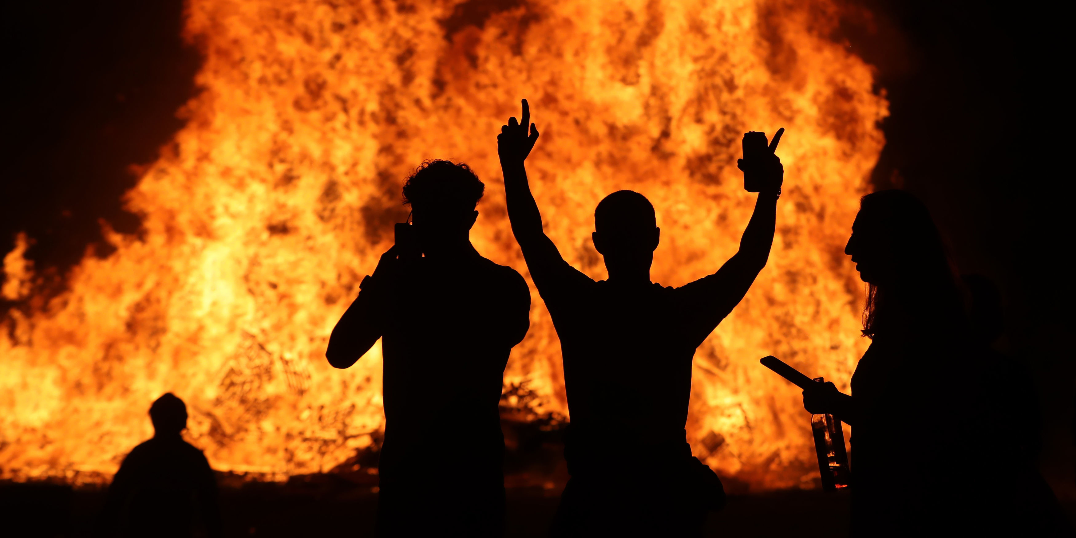 """<p>The huge bonfire in Craigyhill, Larne, is lit on the """"Eleventh night"""" to usher in the Twelfth commemorations. Picture date: Monday July 12, 2021.</p>"""