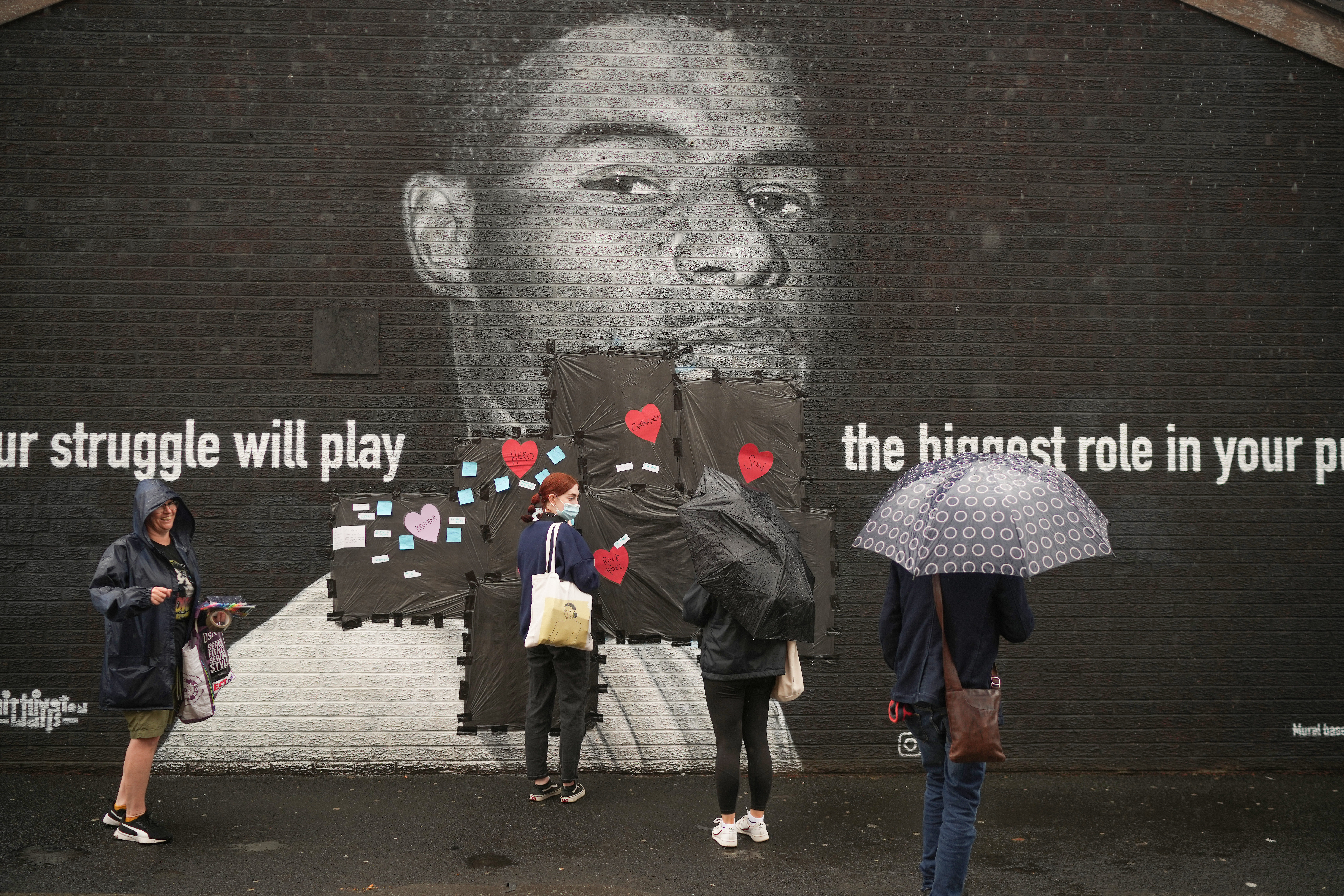<p>MANCHESTER, ENGLAND - JULY 12: Local residents put messages of support on the plastic that covers offensive graffiti on the vandalised mural of Manchester United striker and England player Marcus Rashford on the wall of a cafe on Copson Street, Withington on July 12, 2021 in Manchester, England. Rashford and other Black players on England's national football team have been the target of racist abuse, largely on social media, after the team's loss to Italy in the UEFA European Football Championship last night. England manager Gareth Southgate, Prime Minister Boris Johnson, and the Football Association have issued statements condemning the abuse. (Photo by Christopher Furlong/Getty Images)</p>