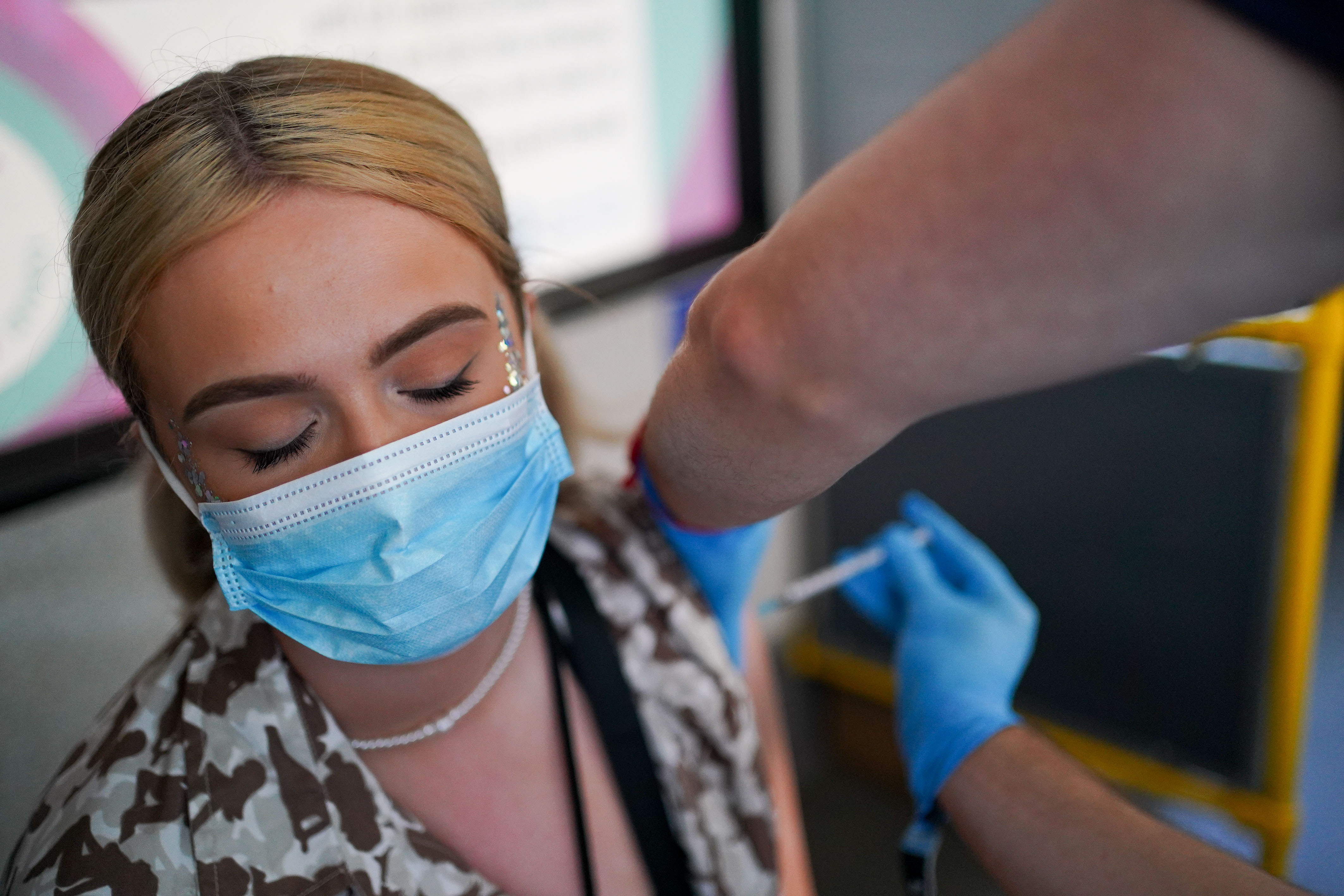 <p>Festival goer Ellie Harries receives her 2nd Pfizer vaccine dose at a Covid-19 vaccination bus at Latitude festival in Henham Park, Southwold, Suffolk. Picture date: Sunday July 25, 2021. (Photo by Jacob King/PA Images via Getty Images)</p>