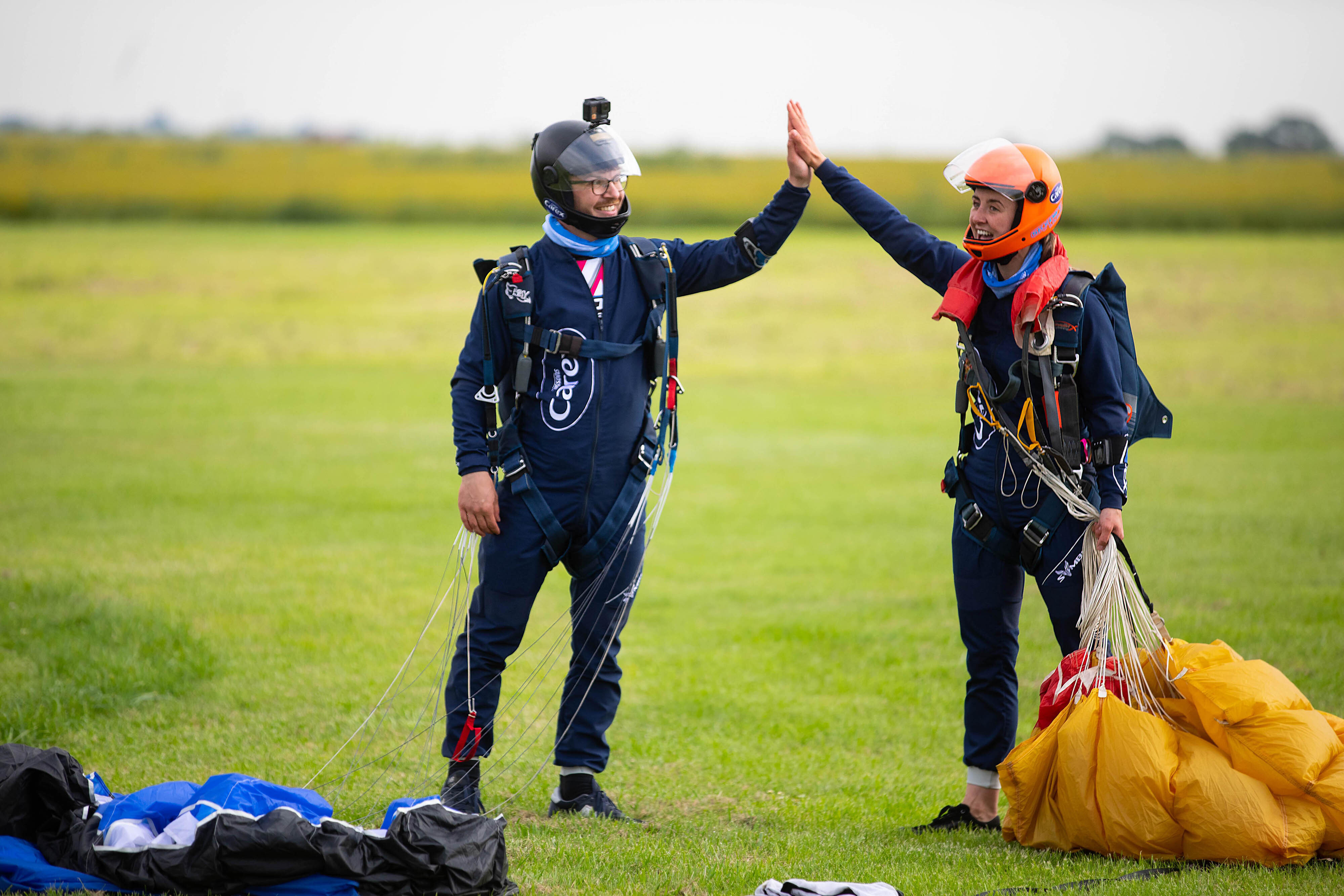 <p>EDITORIAL USE ONLY Professional skydivers, Emily Aucutt (right) and Josh Carratt officially set the Guinness World Record title for 'Most high and low fives by a pair in a single sky dive' at Langar Airfield in Nottingham, as Carex marks the final COVID-19 restrictions lifting today in England to show people how they can get out and about as safely as possible, by carrying sanitiser on the go. Issue date: Monday July 19, 2021.</p>