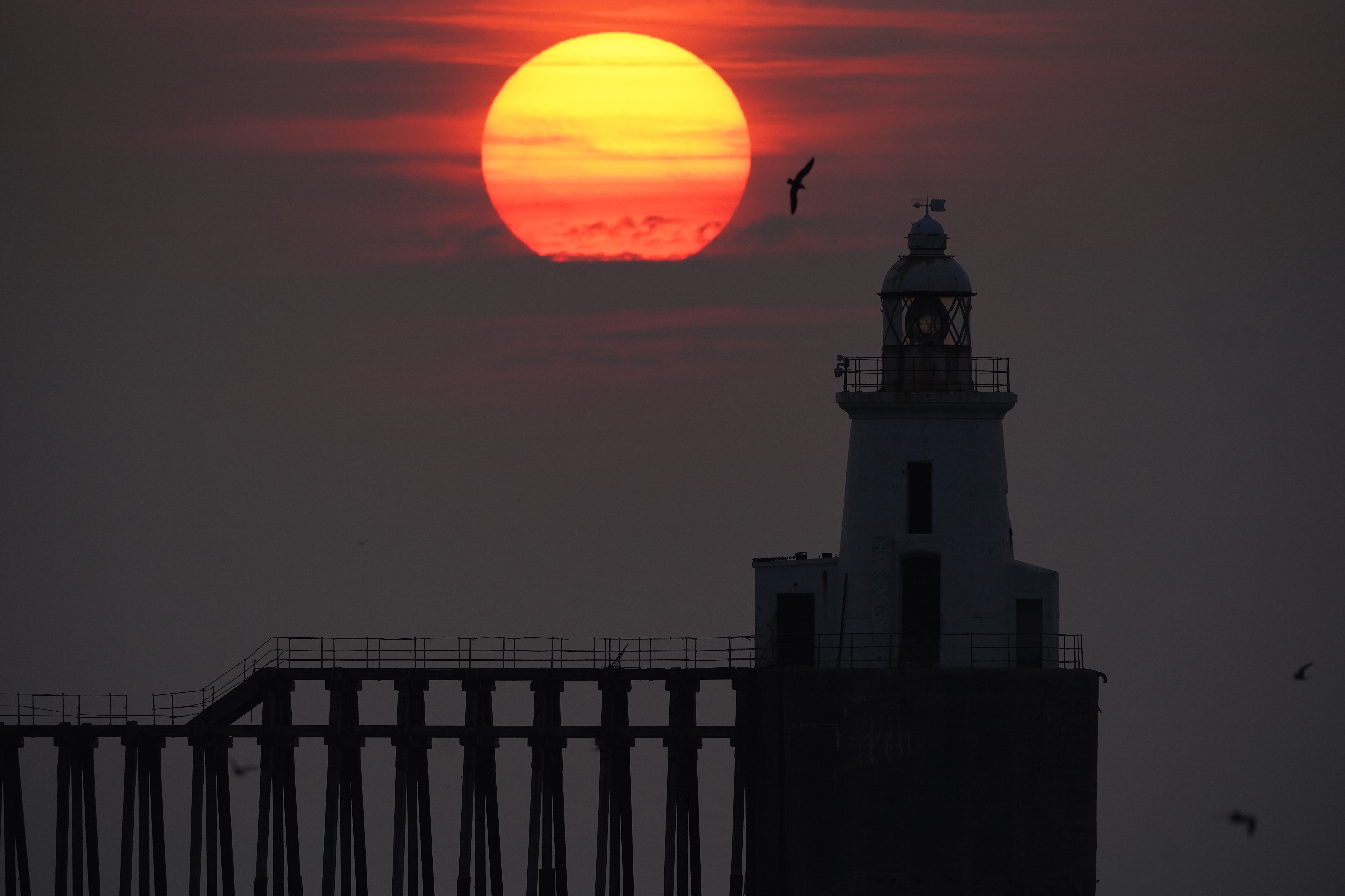 <p>The sun rises through the sea mist at Blyth pier in Northumberland. Picture date: Tuesday July 27, 2021. (Photo by Owen Humphreys/PA Images via Getty Images)</p>