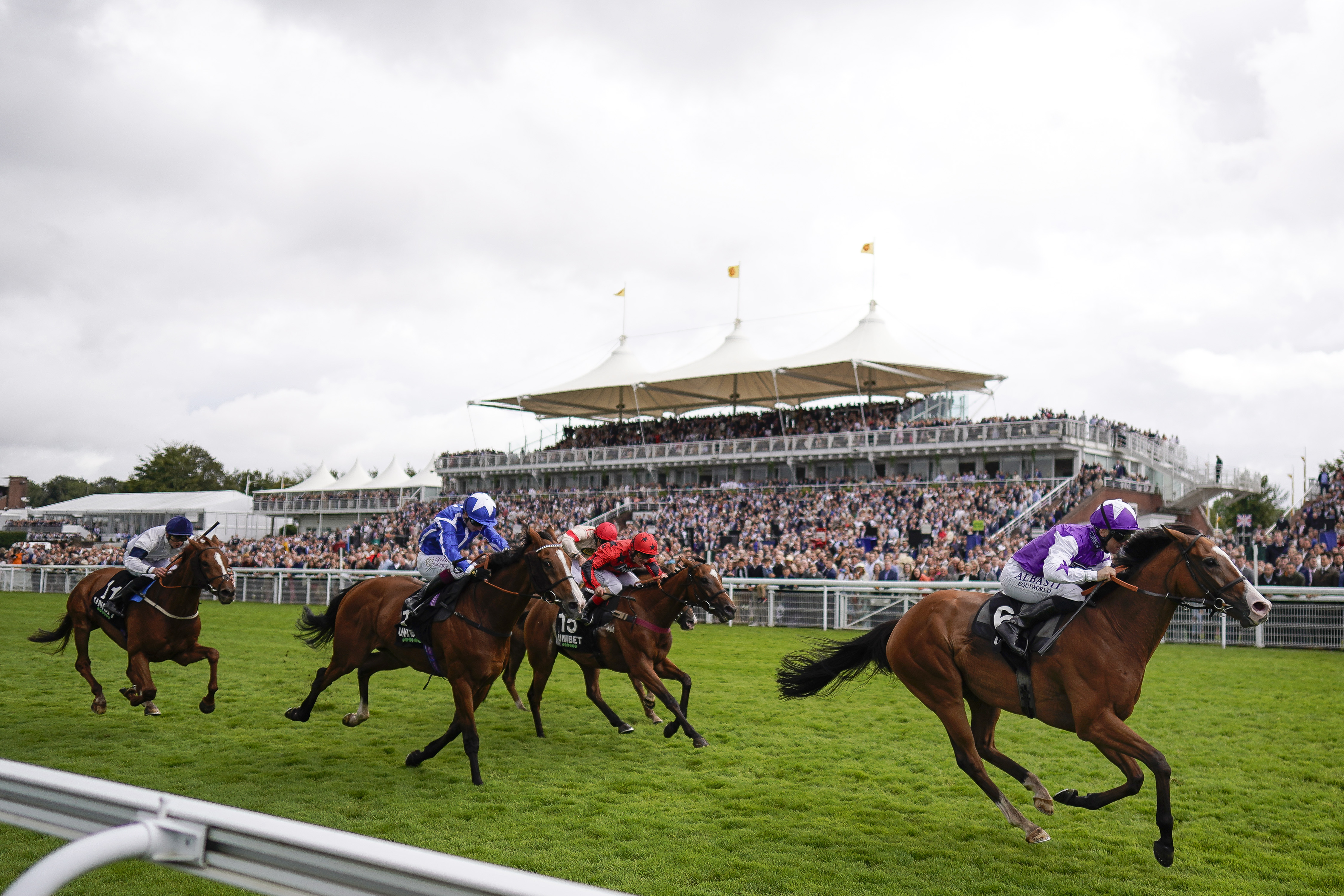 <p>CHICHESTER, ENGLAND - JULY 30: Pat Dobbs riding Calling The Wind win The Unibet 3 Boosts A Day Goodwood Handicap during the Qatar Goodwood Festival at Goodwood Racecourse on July 30, 2021 in Chichester, England. (Photo by Alan Crowhurst/Getty Images)</p>
