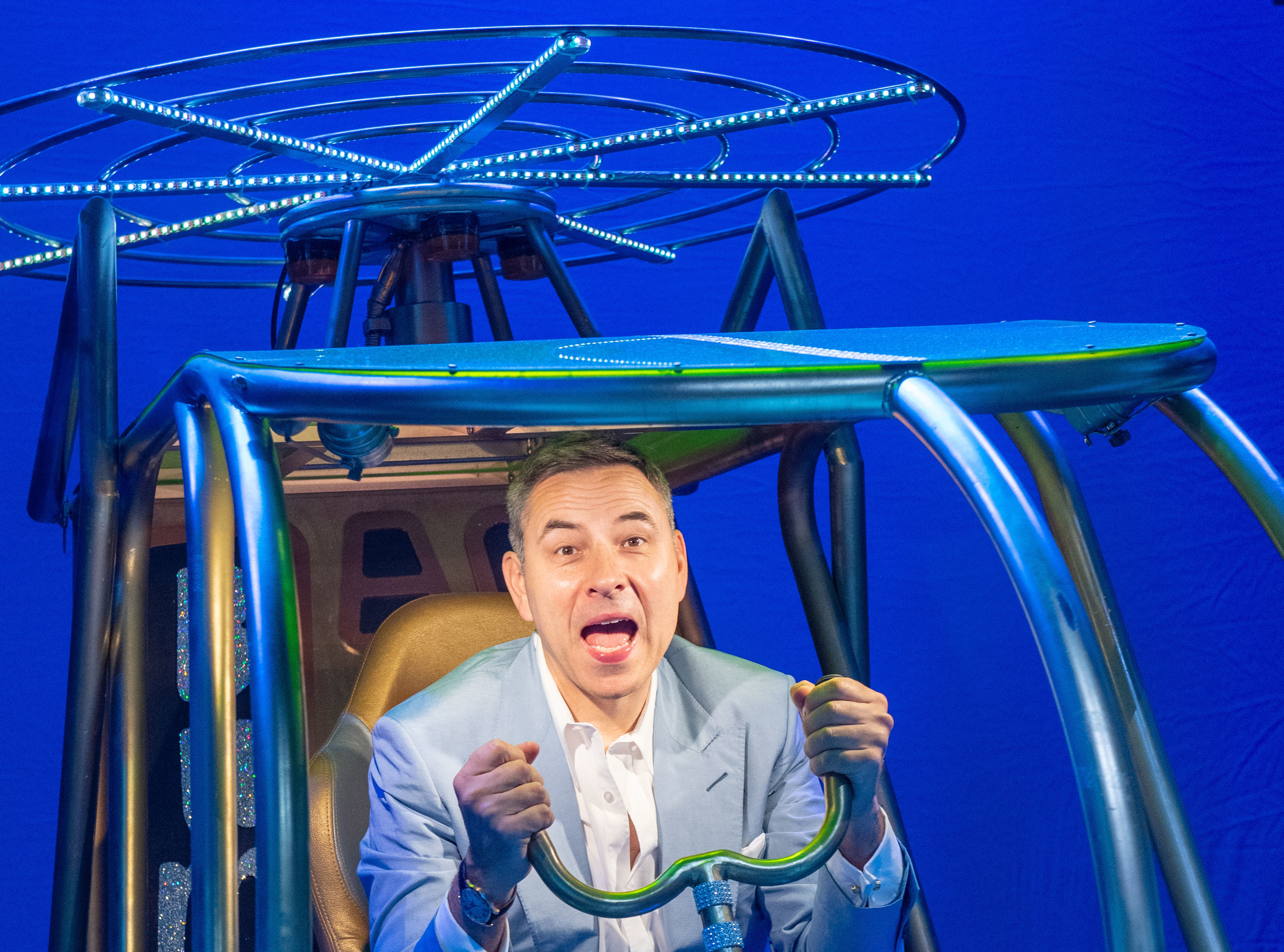 <p>David Walliams sits in a model helicopter onstage at the Garrick Theatre in London, during a visit to meet the cast of Billionaire Boy, the West End production of his best selling children's book, which opens on July 17th. Picture date: Friday July 16, 2021.</p>