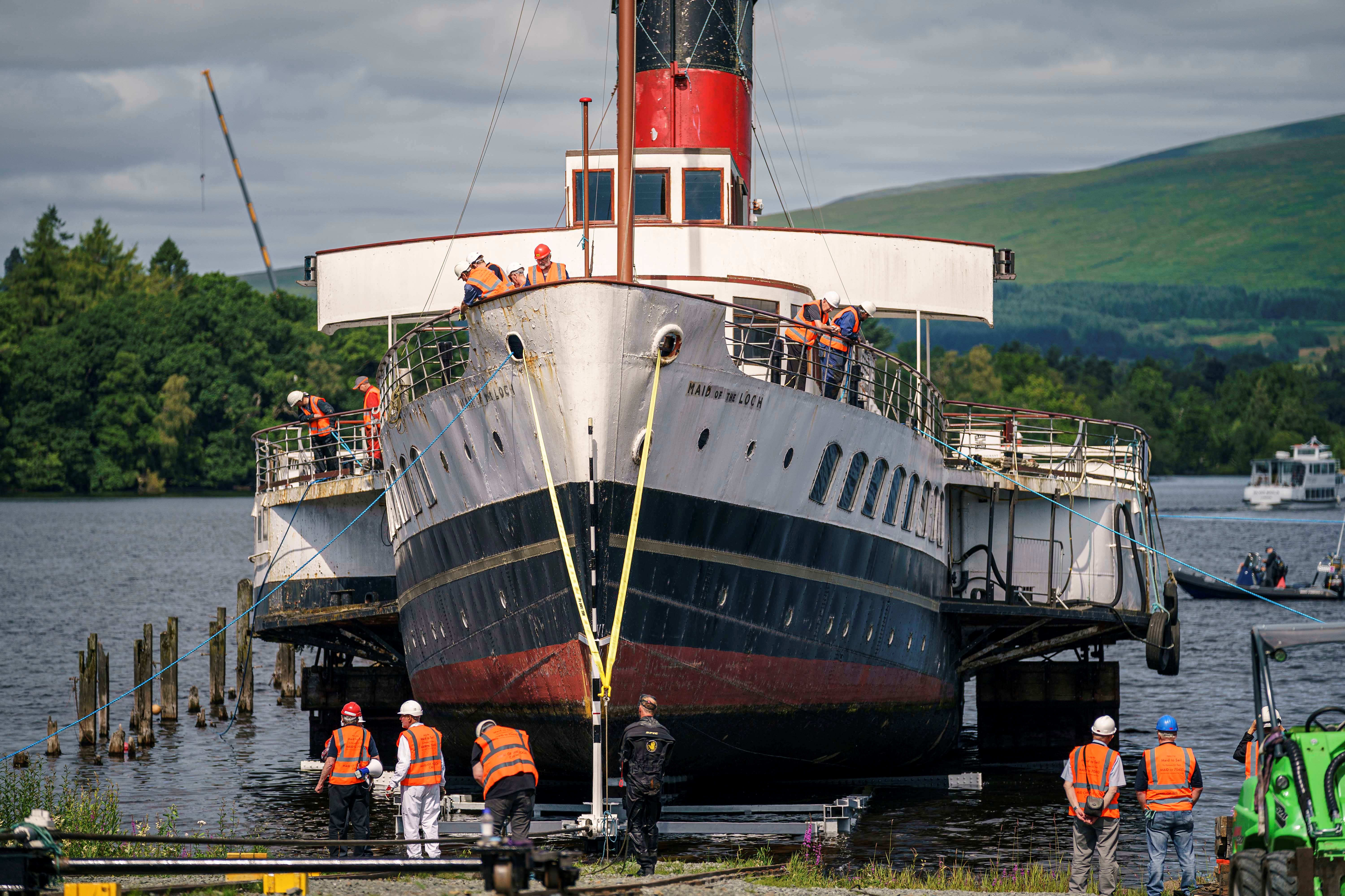 <p>Handout photo of Loch Lomond paddle steamer Maid of the Loch brought onto land for restoration in Balloch. The 430-tonne ship, launched in 1953, has been hauled out of the water for the second time in 40 years for restoration works in a operation which took more than two years to plan. Picture date: Wednesday July 14, 2021.</p>