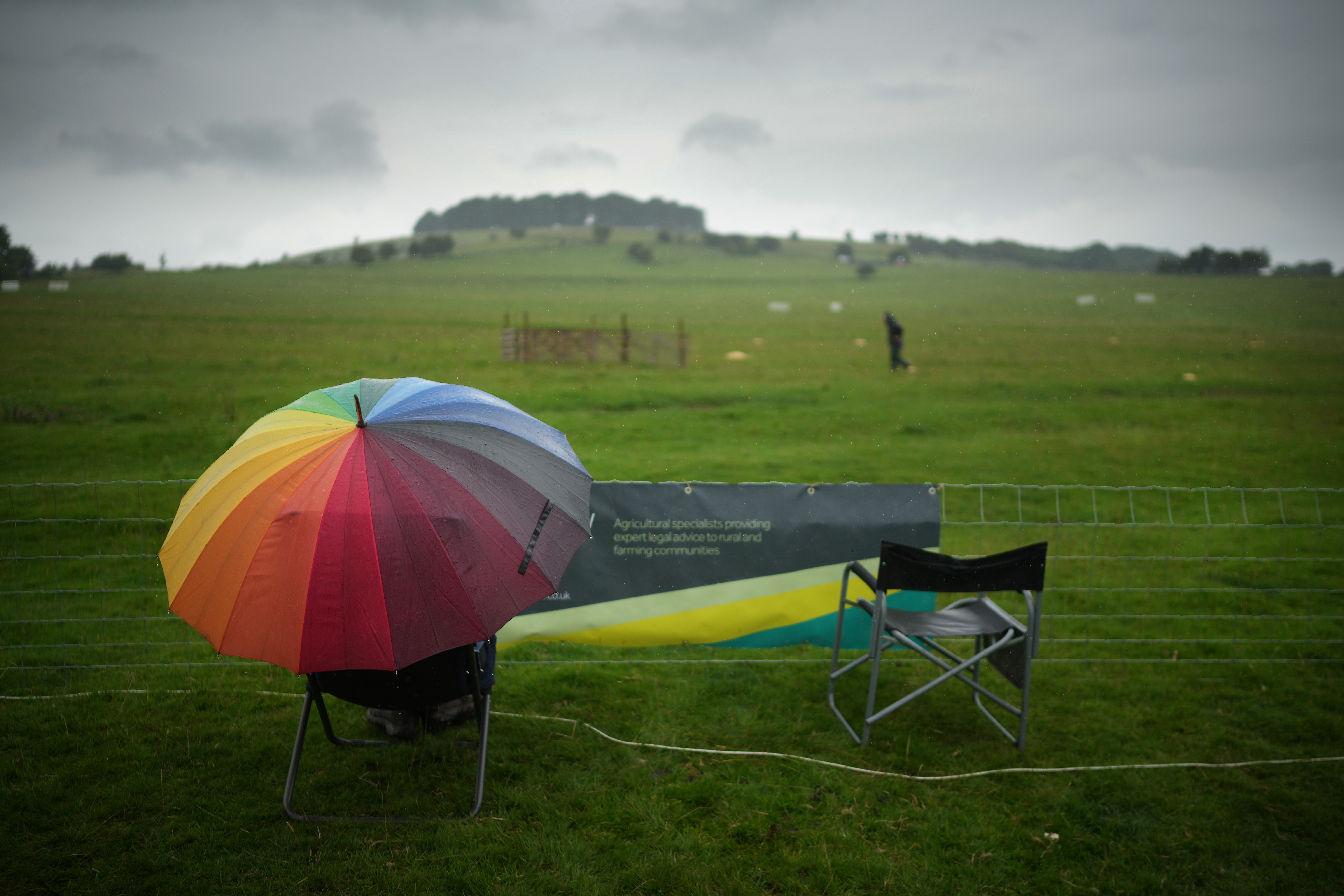 <p>ASHBOURNE, UNITED KINGDOM- JULY 30: Spectators brave the rain during the 2021 English National Sheep Dog Trials at Blore Pastures, near Dovedale, in the Peak District on July 30, 2021 in Ashbourne, United Kingdom. Top handlers and dogs from across England are taking part in the historic trial after last years event was cancelled due to the pandemic. (Photo by Christopher Furlong/Getty Images)</p>