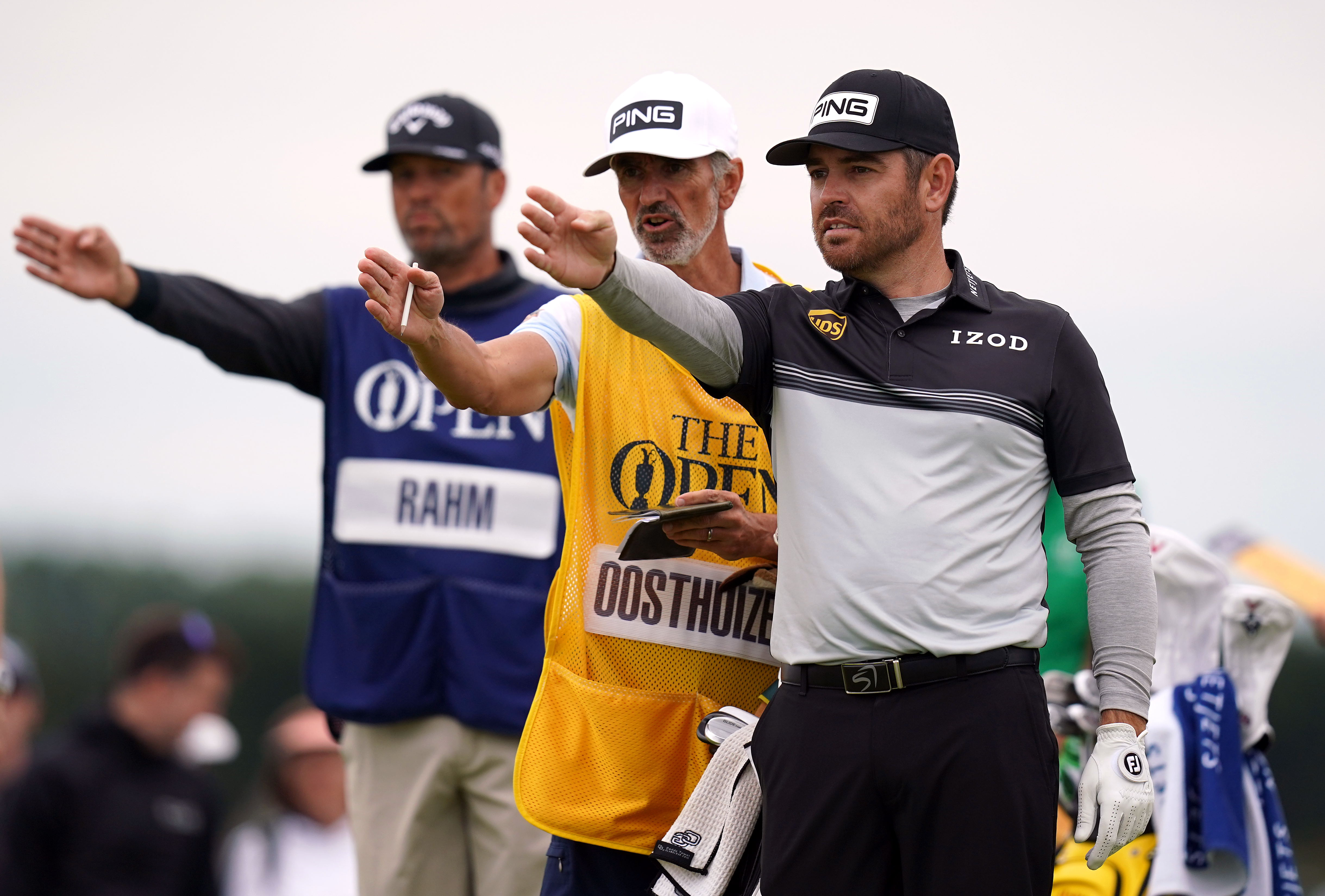 <p>South Africa's Louis Oosthuizen lines up a shot on the 16th tee with the help of his caddie during day one of The Open at The Royal St George's Golf Club in Sandwich, Kent. Picture date: Thursday July 15, 2021.</p>