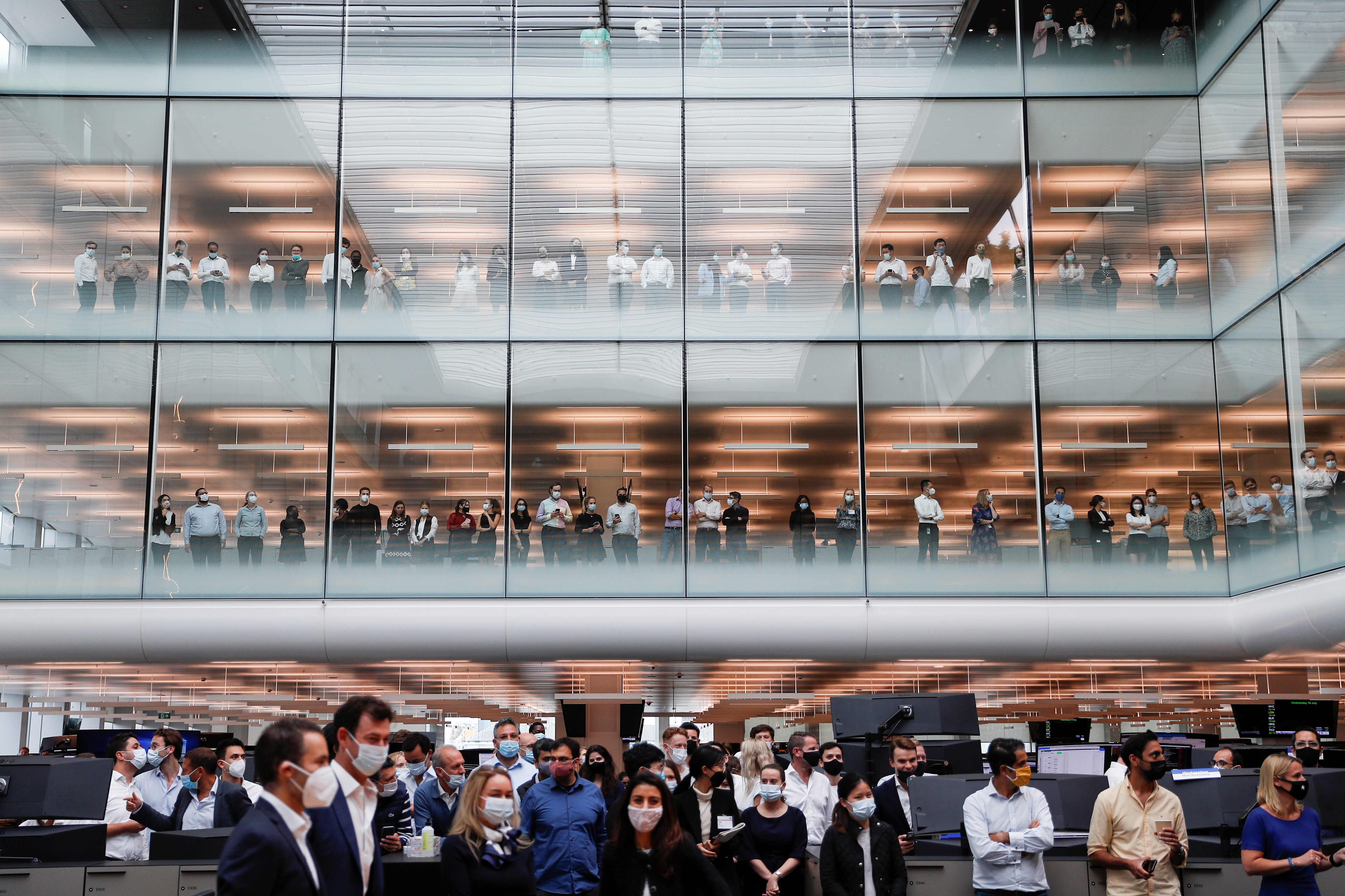 <p>Staff members watch during a visit by the Prince of Wales to Goldman Sachs in central London, to recognise the firm's commitment to the UK. Picture date: Wednesday July 14, 2021.</p>