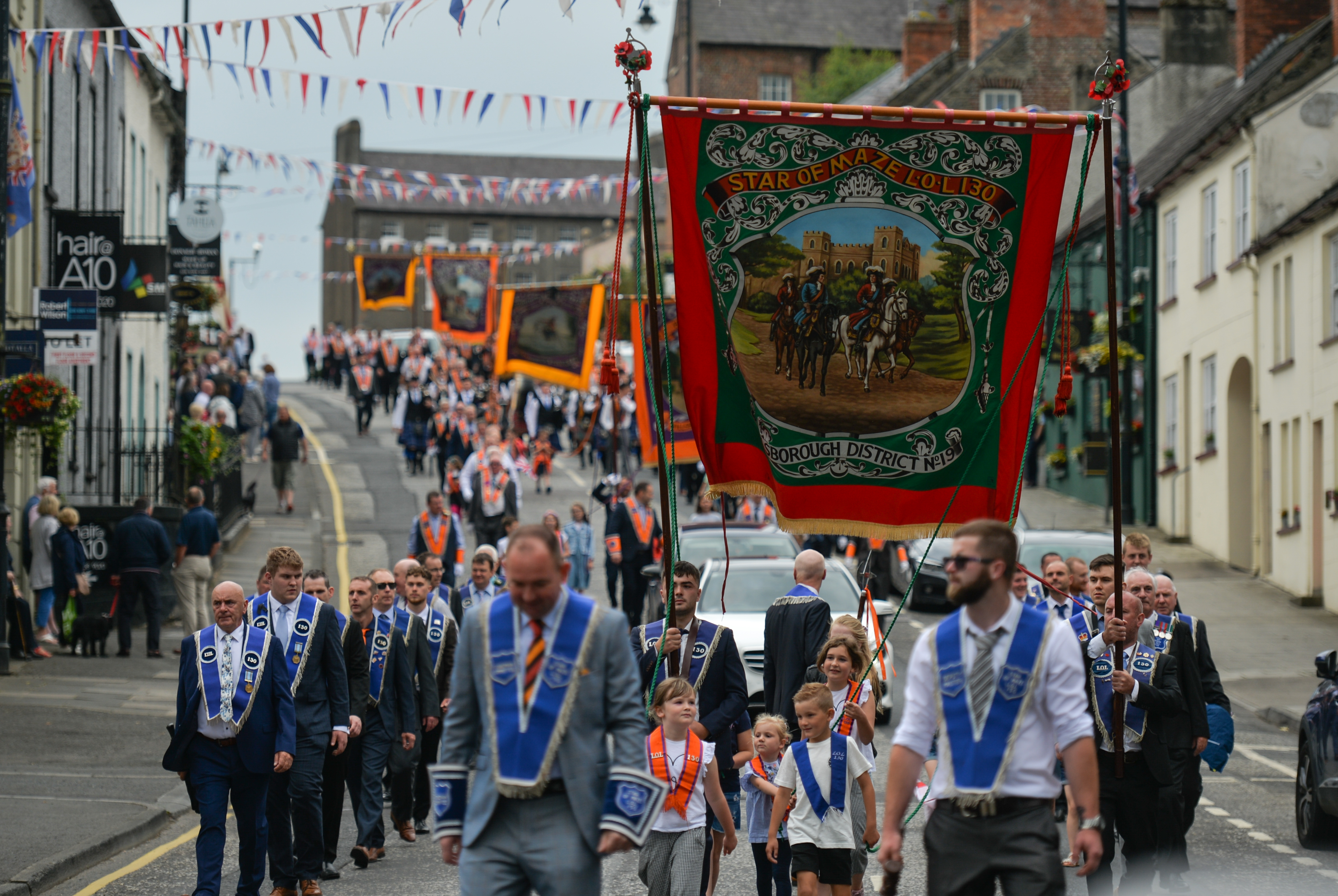 <p>Members of the Orange Order and their supporters take part in the Twelfth of July parade in Hillsborough village as part of the celebrations which marks the victory of King William of Orange over the catholic King James at the Battle of the Boyne in 1690.  On Sunday, 12 July 2021, in Hillsborough, County Down,  Northern Ireland (Photo by Artur Widak/NurPhoto via Getty Images)</p>