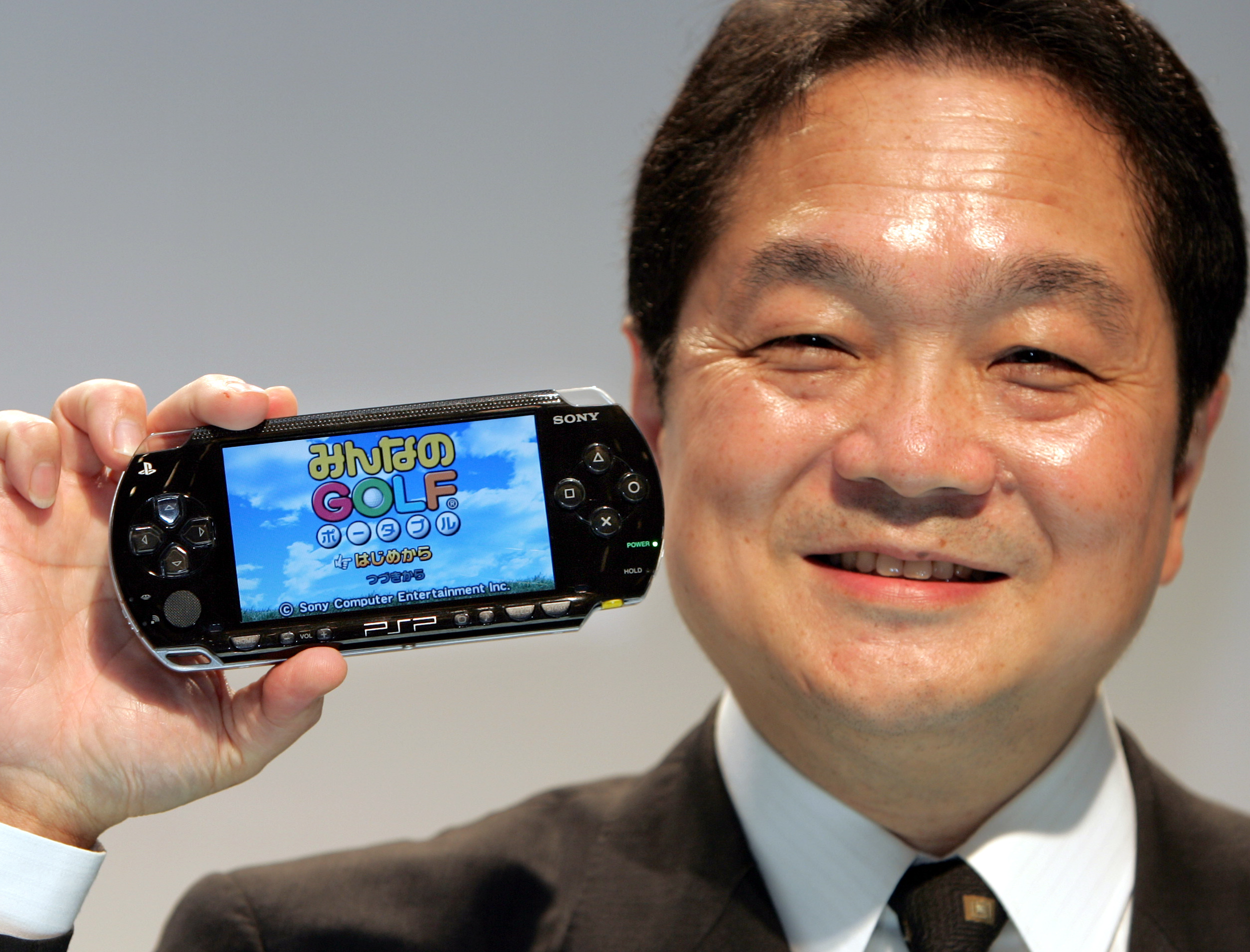 Sony Computer Entertainment President and Chief Exective Officer Ken Kutaragi displays PlayStation Portable (PSP) in Tokyo September 21, 2004. Sony kept secret on Tuesday about the detail of its own handheld game machine PSP, such as its price and launch date, but it unveiled a plan to launch a new version of its popular PlayStation 2 (PS2) game console in the United States and Europe on November 1 at a price of $149 and 149 euros ($181) respectively. Following the overseas launch, Sony plans to start selling the smaller version of the PS2 in Japan on November 3 at around 20,000 yen ($182). REUTERS/Issei Kato  IK/CP