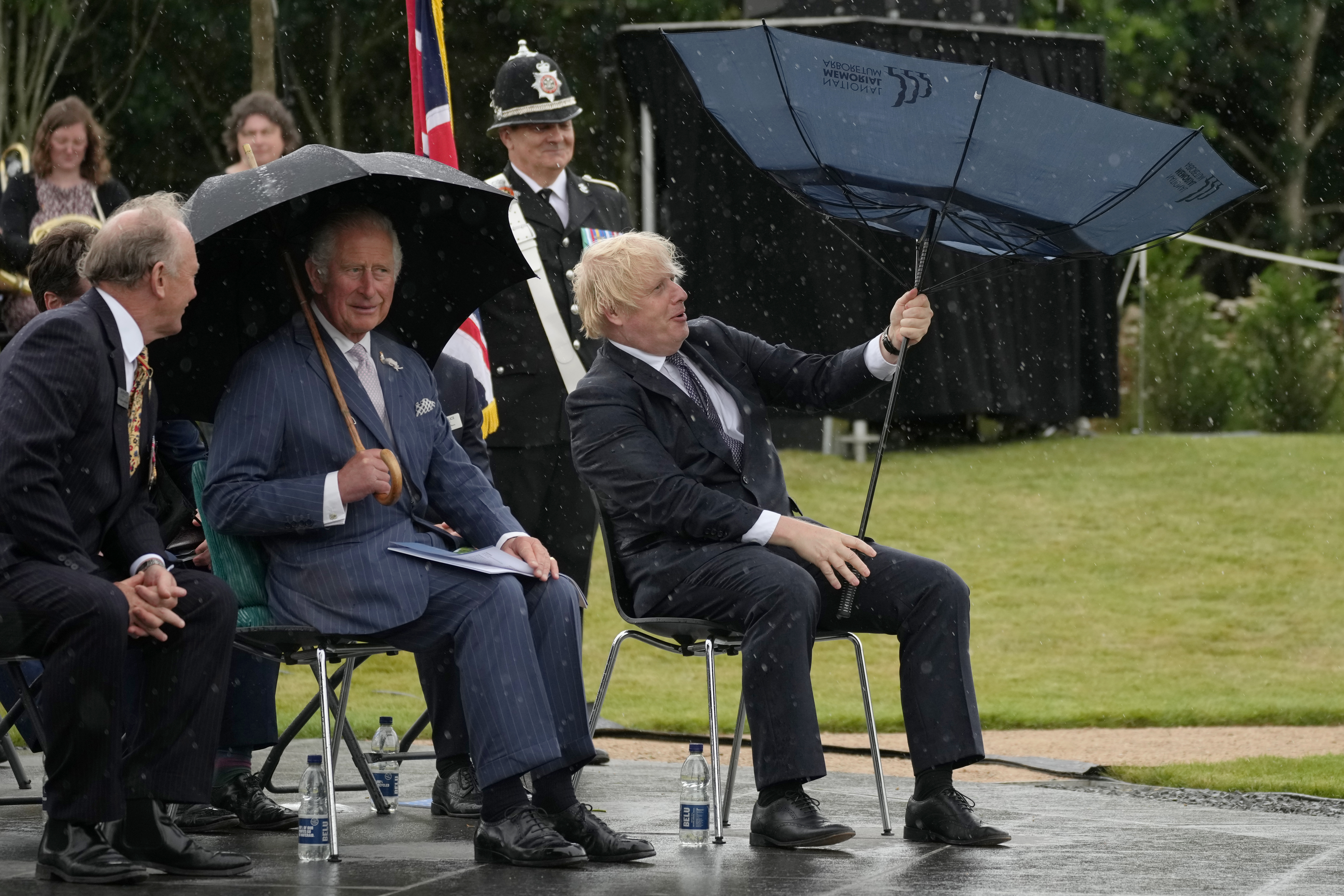 <p>The Prince of Wales (centre) looks on as Prime Minister Boris Johnson opens an umbrella at the unveiling of the UK Police Memorial at the National Memorial Arboretum at Alrewas, Staffordshire. The �4.5 million memorial commemorates all personnel who have lost their lives since the 1749 formation of the Bow Street Runners. Picture date: Wednesday July 28, 2021.</p>