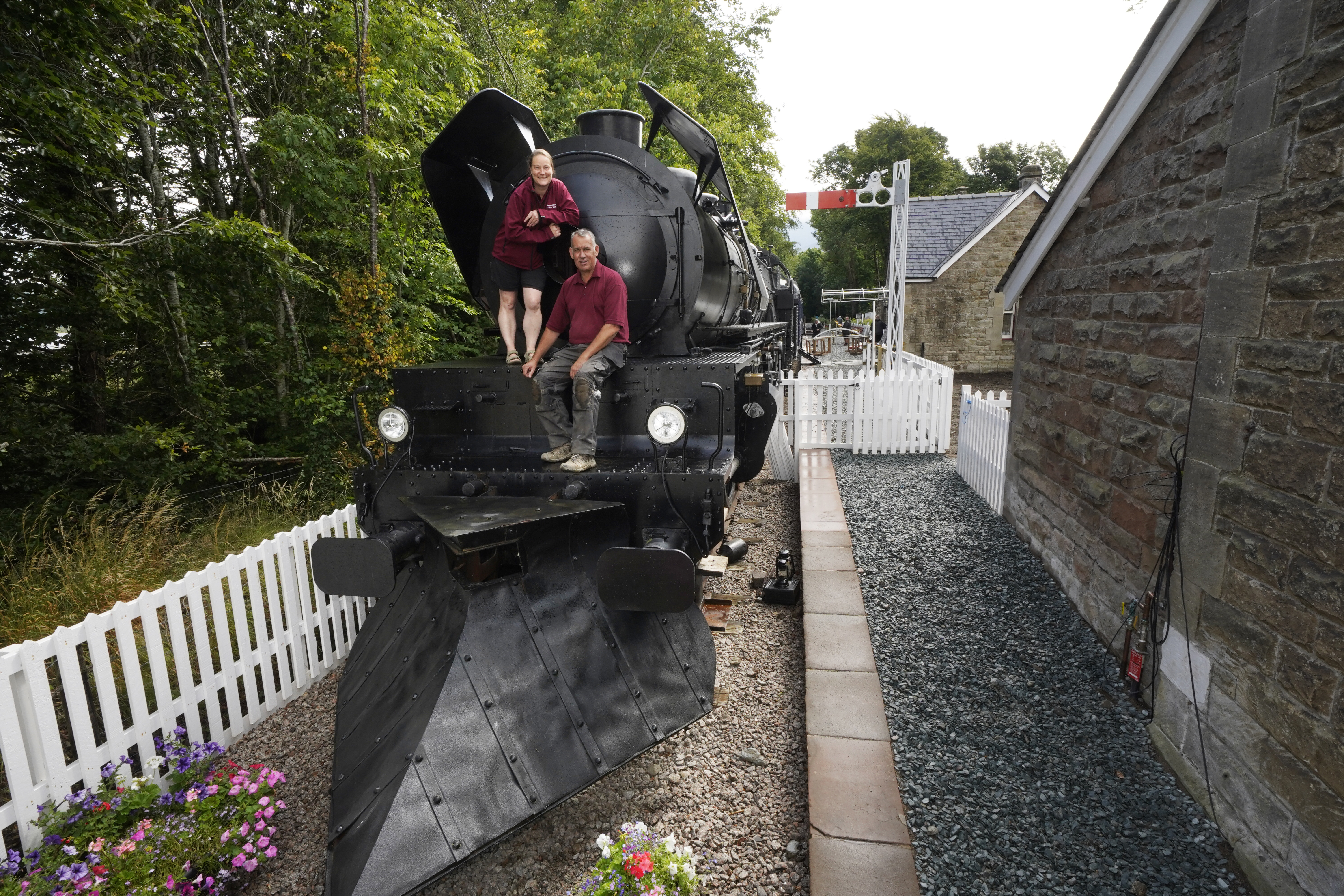 <p>Simon and Diana Parums with their full size steam train with carriages, tracks and platform as they converted and restored Bassenthwaite Lake station in Keswick, offering a dining experience on a Hollywood movie restaurant carriage as its centrepiece, when they open it to the public as an attraction. Picture date: Wednesday July 28, 2021.</p>