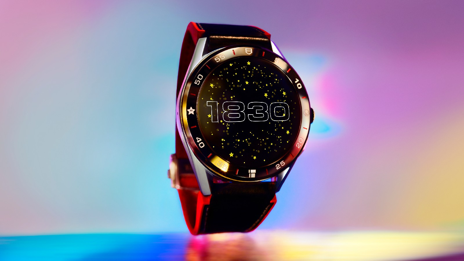 <p>Tag Heuer Connected Limited Edition Super Mario with a red-and-black strap. The watch face features the numbers 1830 in retro font, against a background of stars.</p>