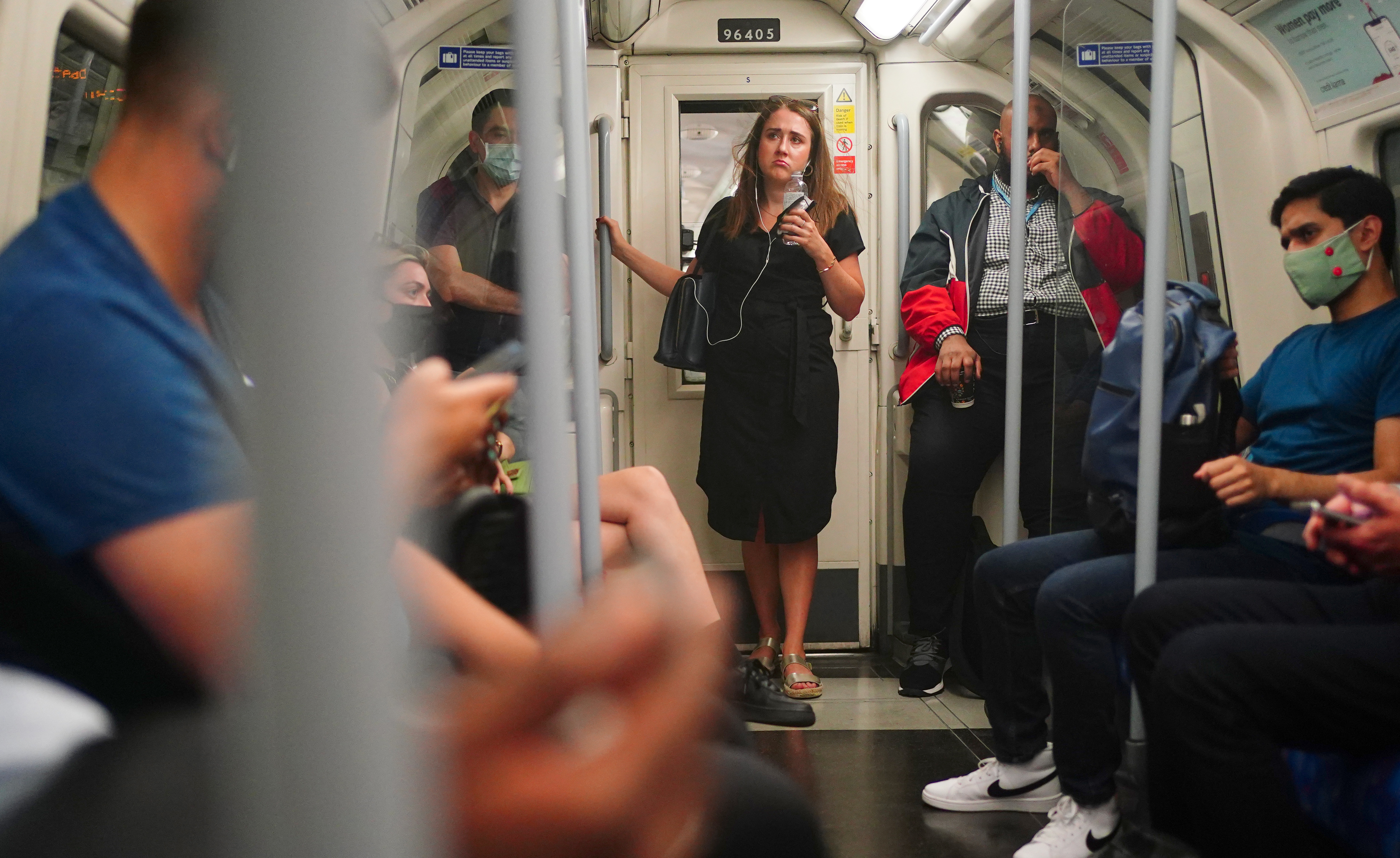 <p>Commuters, some not wearing facemasks, on a Jubilee Line train at 0856 in London after the final legal Coronavirus restrictions were lifted in England. Picture date: Monday July 19, 2021.</p>