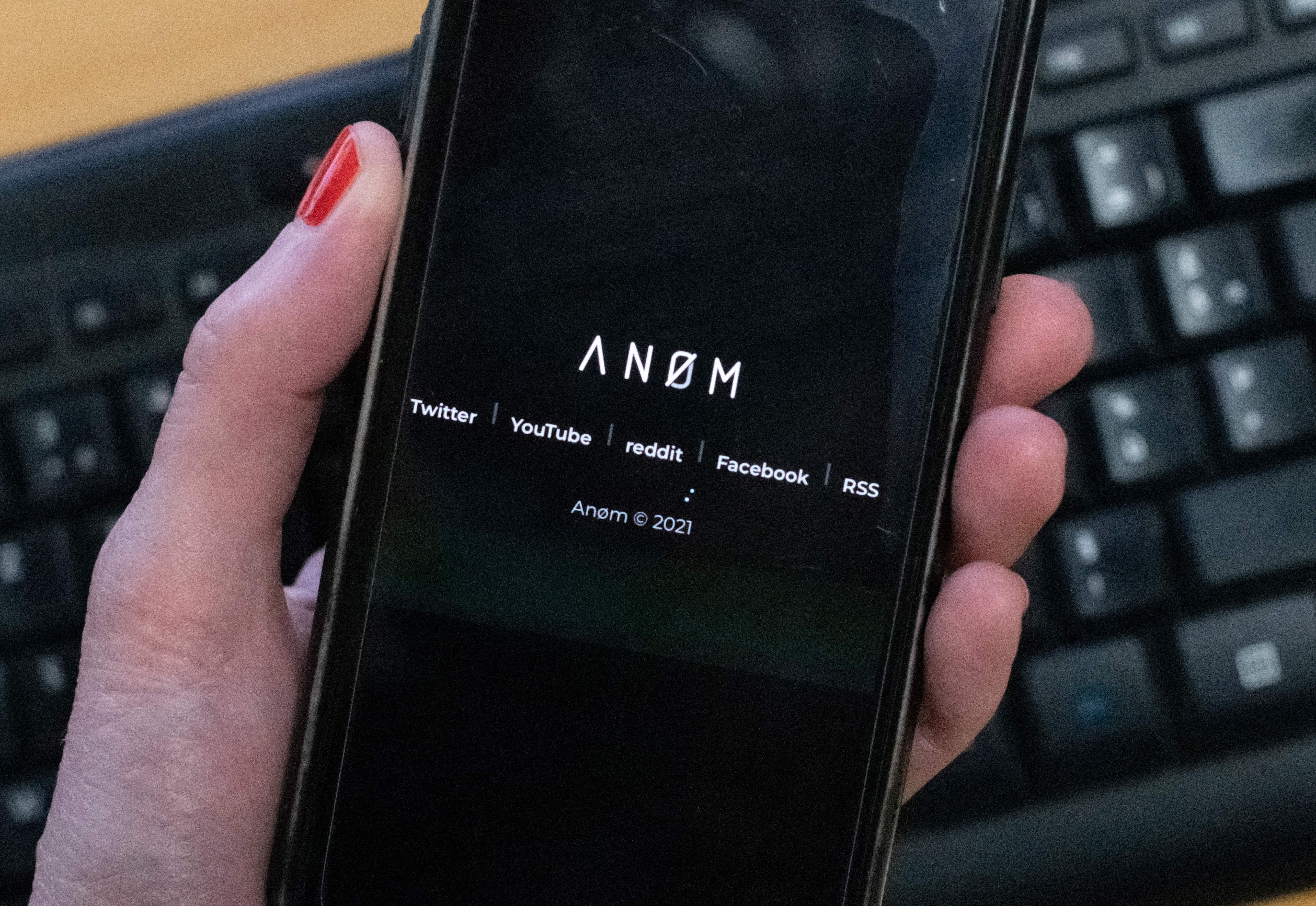 An illustration picture shows the ANoM logo displayed on the screen of an smartphone on june 8, 2021 in Paris. - Some 250 people were arrested in Sweden and Finland in the global sting on organised crime, authorities said on June 8, 2021, using phones planted by the US FBI, law enforcement officers were able to read the messages of global underworld figures in around 100 countries as they plotted drug deals, arms transfers and gangland hits on the compromised ANOM devices. (Photo by Olivier MORIN / AFP) (Photo by OLIVIER MORIN/AFP via Getty Images)