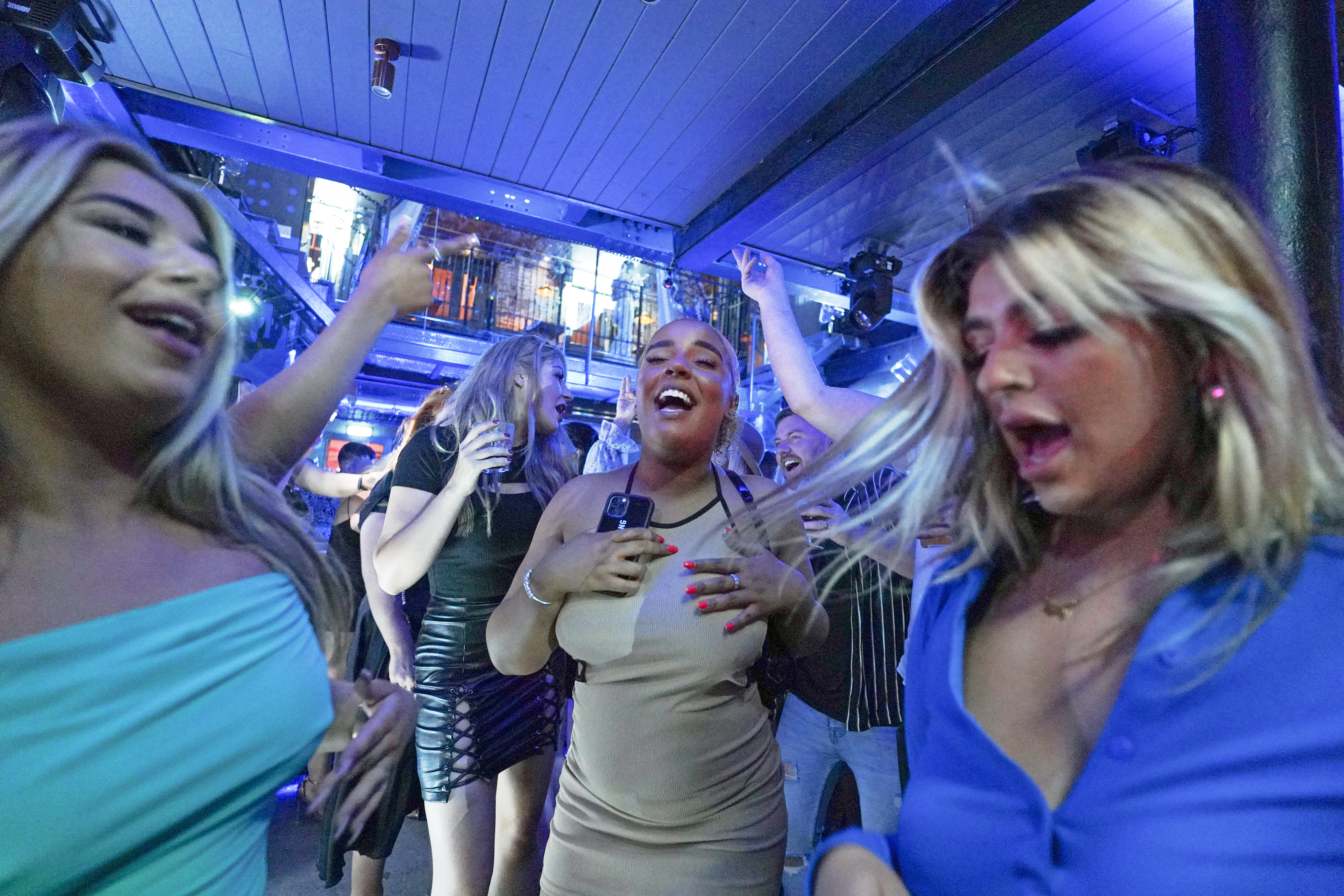 <p>People dancing in Bar Fibre in Leeds, after the final legal coronavirus restrictions were lifted in England at midnight. Picture date: Monday July 19, 2021.</p>
