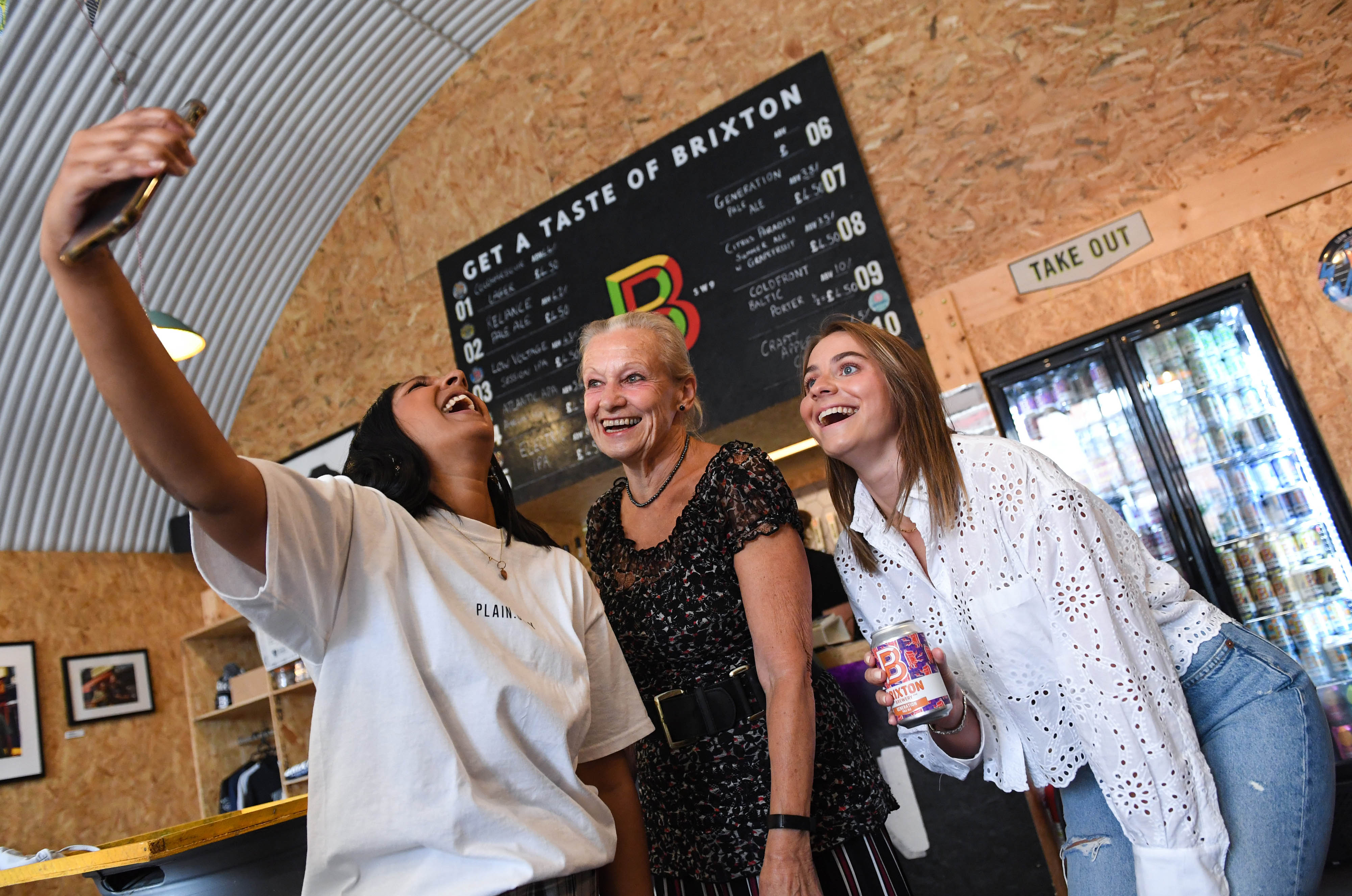 <p>EDITORIAL USE ONLY Tasha Chellen (left), 36, and Philippa Jackson (right), 29 are joined by Mary Cox, 69, at the 'Bring Your Gran for A Can' event, hosted by Brixton Brewery and Age UK Lambeth to launch Generation Pale Ale, the first beer designed to raise money for the elderly, London. Picture date: Thursday July 28, 2021.</p>