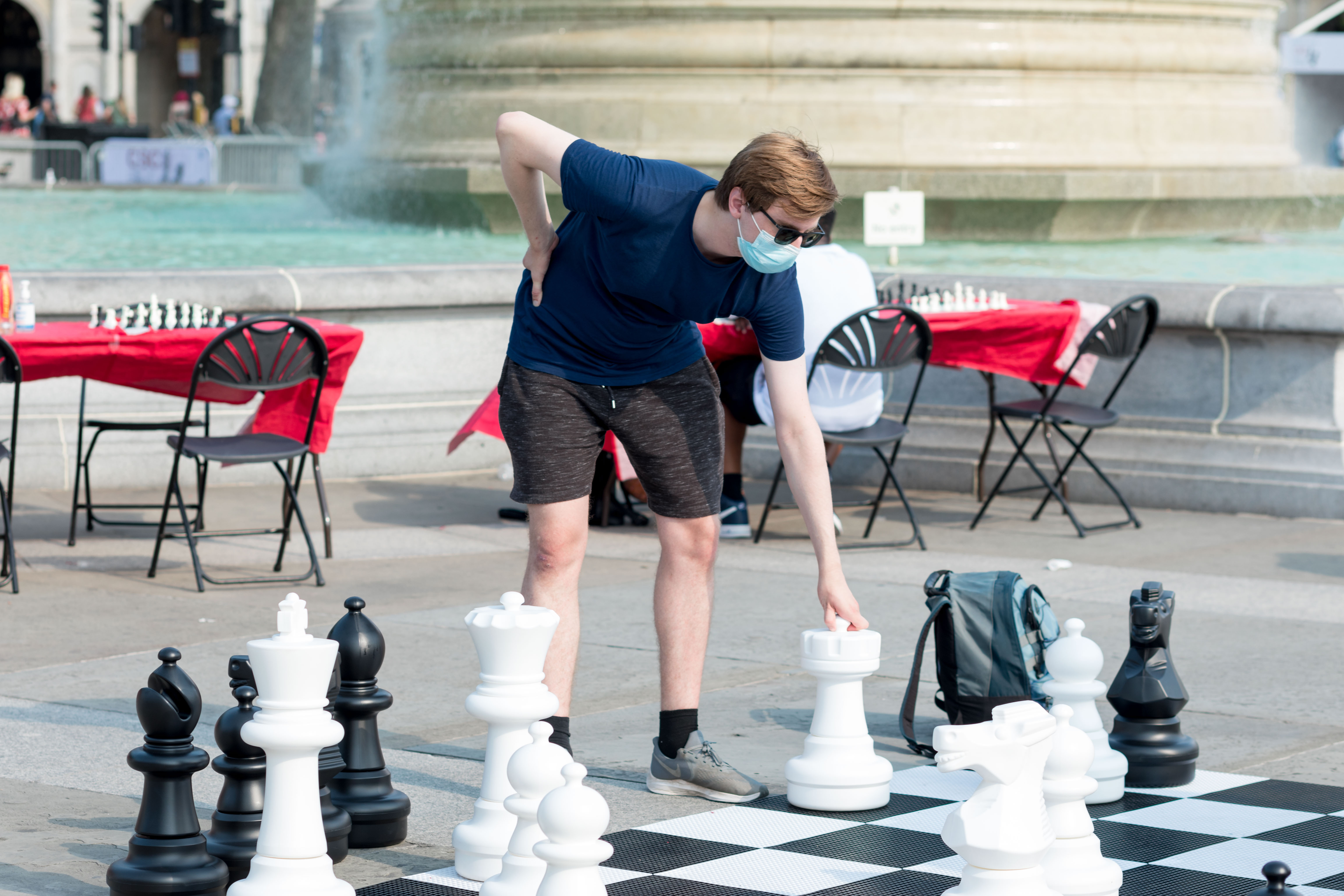 <p>A man seen taking his next move while playing on the life-sized chess set. The Chess Fest, held by Chess in Schools and Communities (CSC), supported by Mayor of London and XTX Markets, took place on the 18th of July at Trafalgar Square in London. Free chess lessons were offered from professional chess teachers and top UK players, and giant life-sized chessboards were set up for people to play on. The festival was held to promote the playing of chess as an intellectually stimulating activity. (Photo by Belinda Jiao / SOPA Images/Sipa USA)</p>