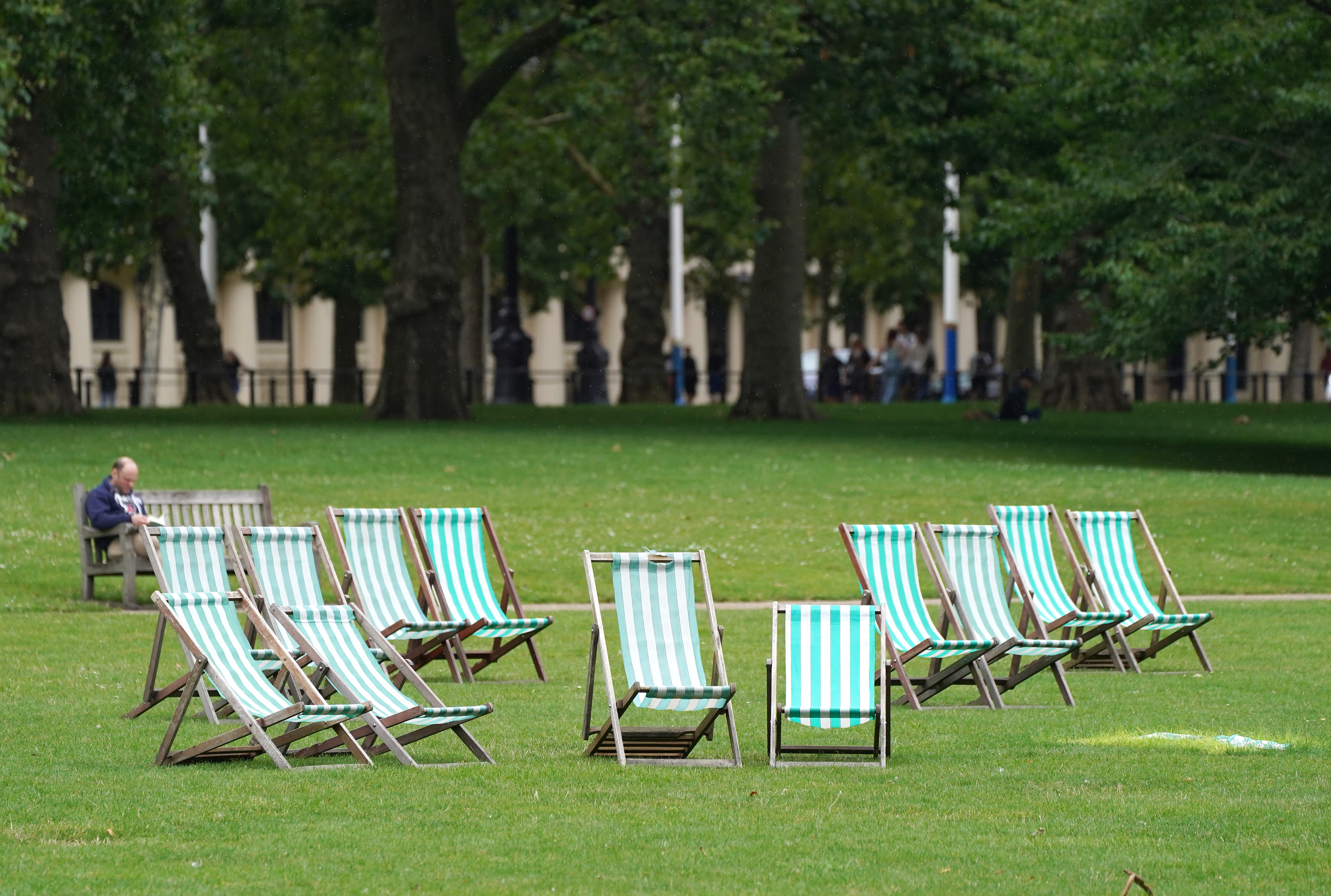 <p>Empty deck chairs in St. James Park in London. Picture date: Monday August 2, 2021.</p>