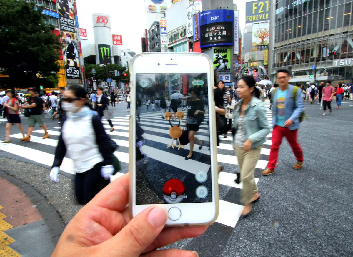Nintendo's Pokemon Go game is played on a mobile phone at Tokyo's famous Shibuya crossing on July 22, 2016. The augmented-reality (AR) game PokemonGO was released in Japan. YOSHIKAZU TSUNO/GAMMA-RAPHO