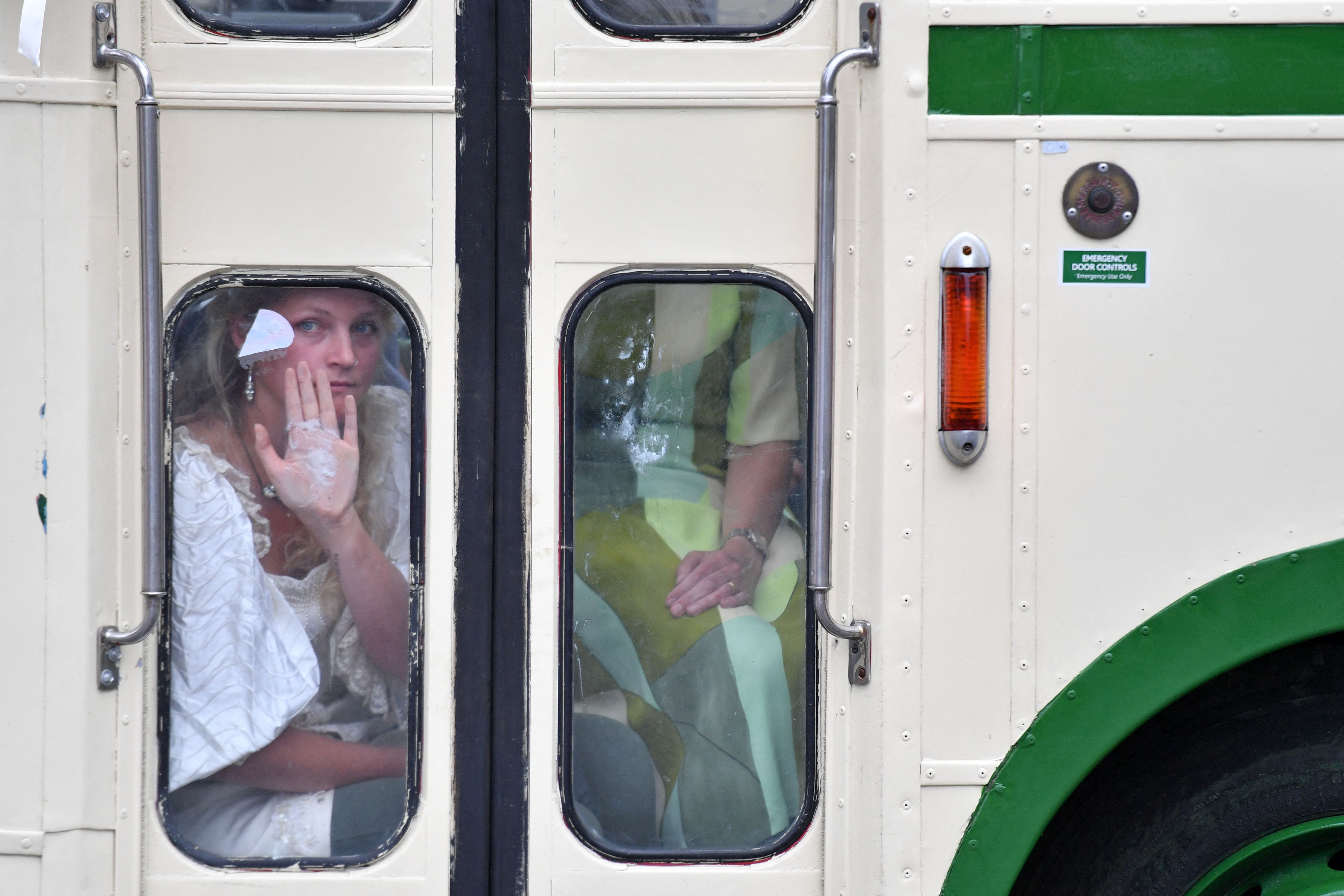 <p>A protester shows her glued palm against a window, as police officers surround a vehicle parked across the road by climate activists from the Extinction Rebellion group, blocking the road over London Bridge in central London on August 31, 2021 during the group's 'Impossible Rebellion' series of actions. - Climate change demonstrators from environmental activist group Extinction Rebellion continued with their latest round of protests in central London, promising two weeks of disruption. (Photo by JUSTIN TALLIS / AFP) (Photo by JUSTIN TALLIS/AFP via Getty Images)</p>