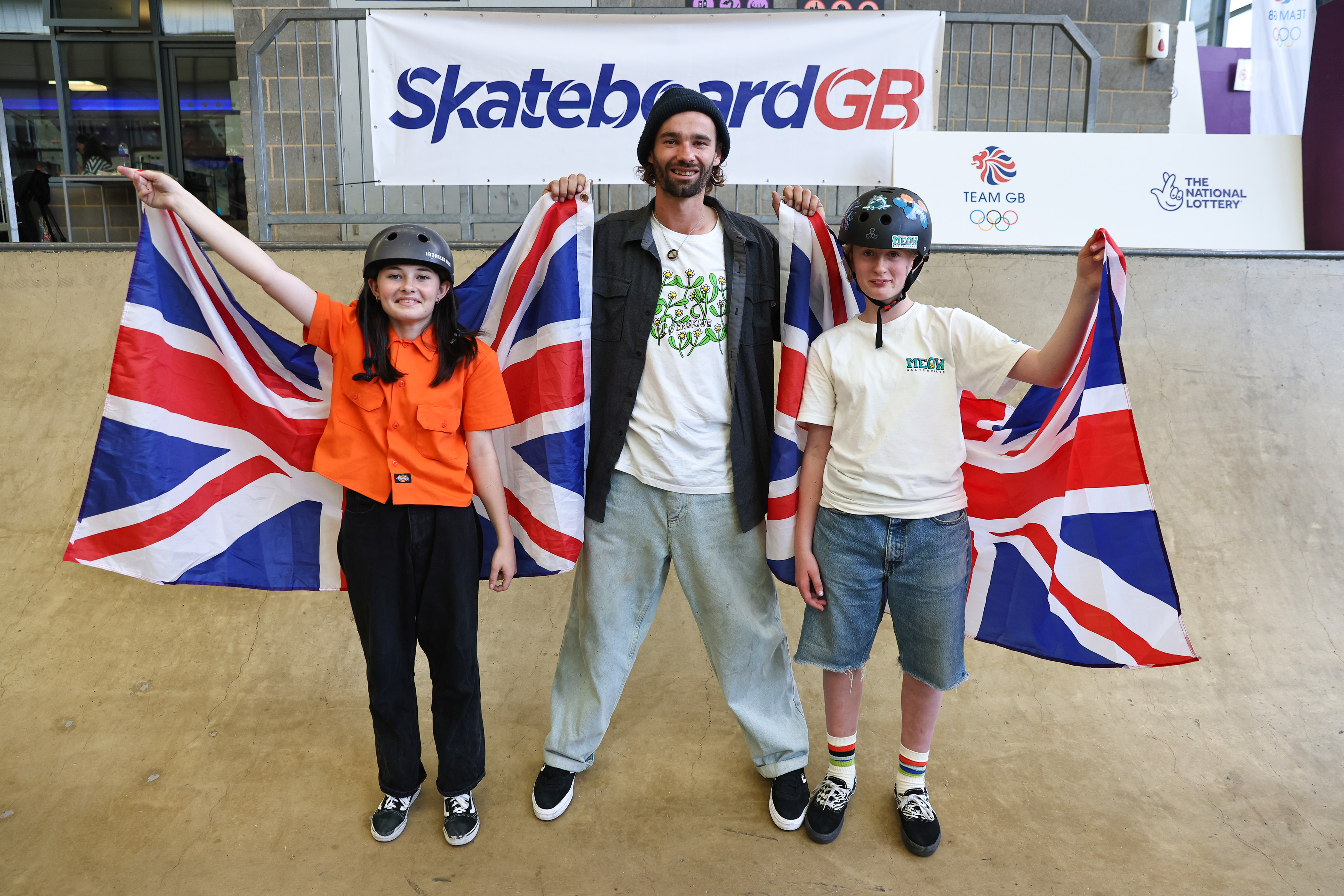 <p>HEMEL HEMPSTEAD, ENGLAND - AUGUST 04: Lola Tambling, Alex Halford and Miriam Nelson pose with the GB flag as Team GB Sky Brown's Olympic Bronze medal inspires the next generation of female skateboarders at the XC on August 4, 2021 in Hemel Hempstead, England. (Photo by Marc Atkins/Getty Images for National Lottery)</p>