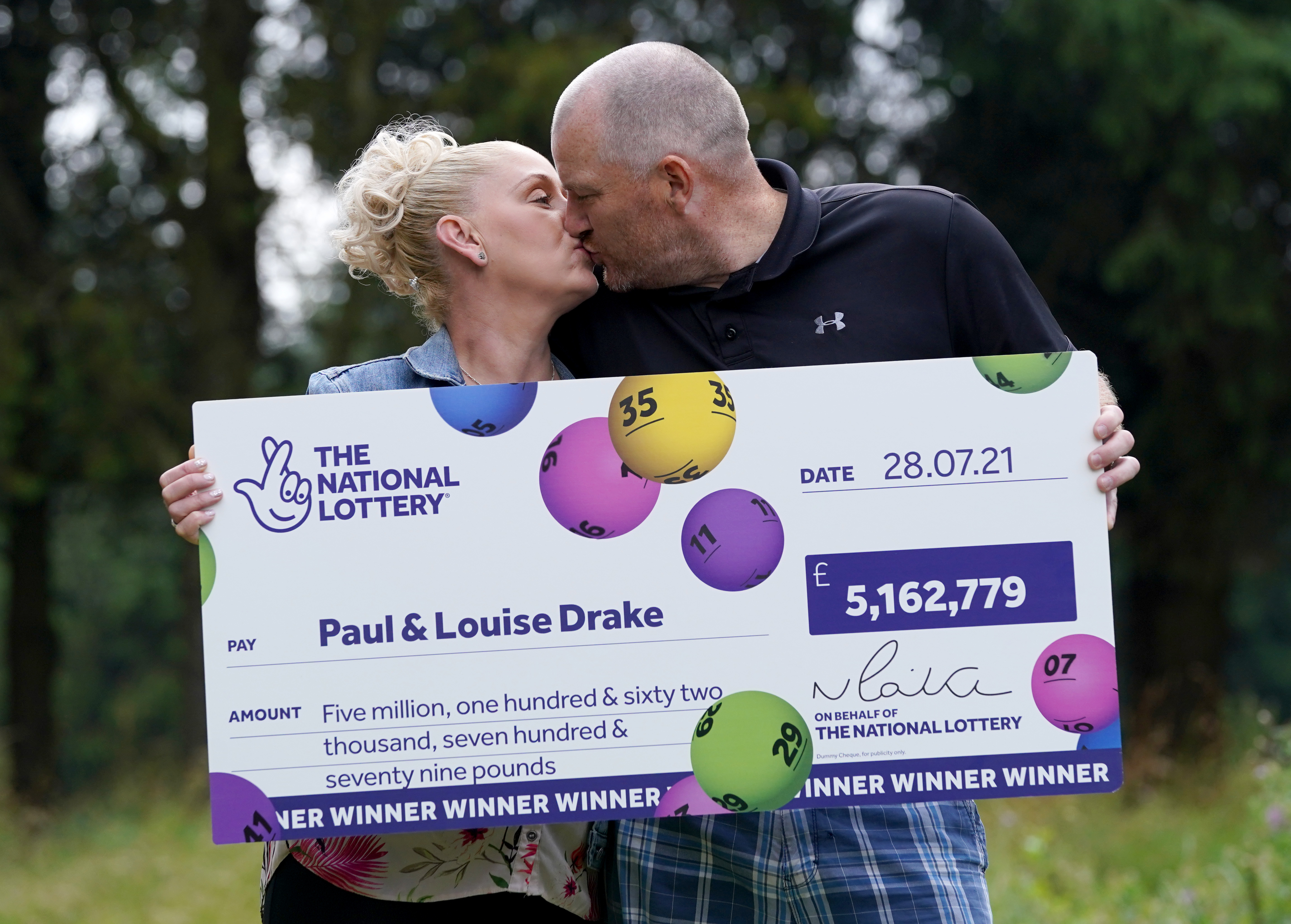 <p>Paul and Louise Drake celebrating their �5.16 million pound lottery win at Deer Park Golf and Country Club in Livingston, West Lothian. Paul and Louise, a district nurse, live with their two sons, aged 11 and 15, in Seafield near Bathgate, Edinburgh. Picture date: Friday August 6, 2021.</p>