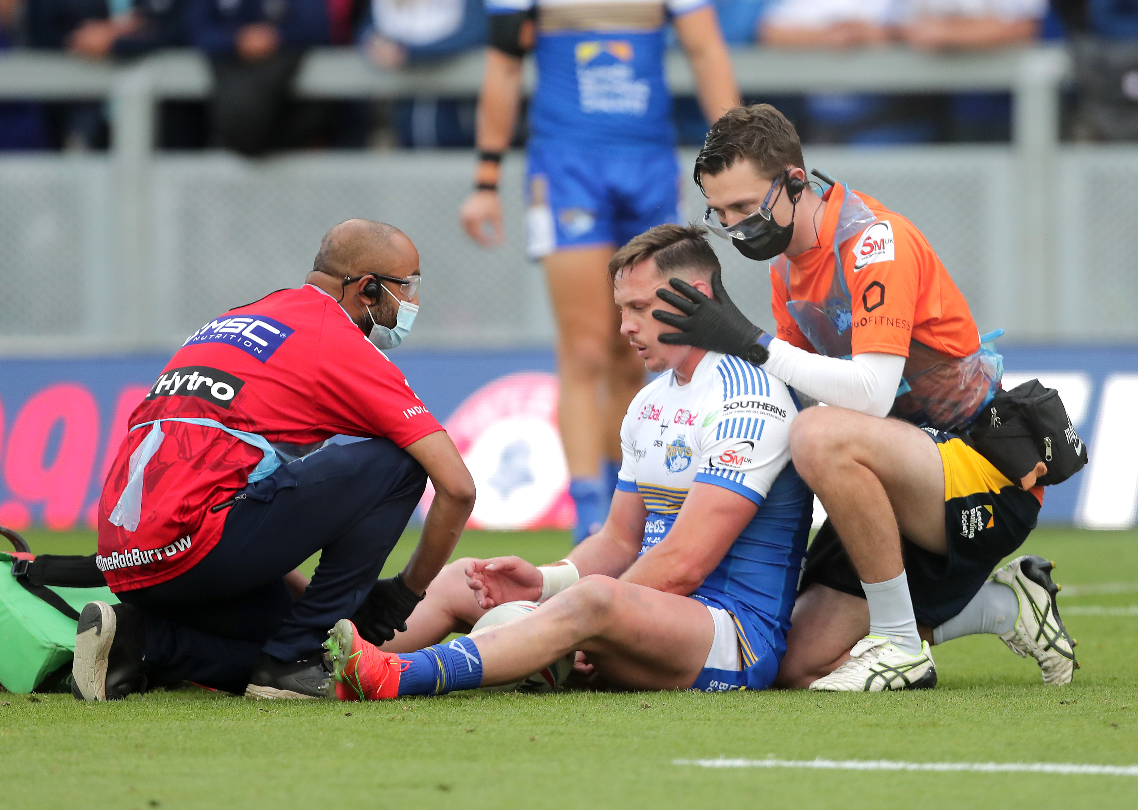 <p>Leeds Rhinos' James Donaldson receives treatment for a possible head injury during the Betfred Super League match at Emerald Headingley Stadium, Leeds. Picture date: Sunday August 1, 2021.</p>