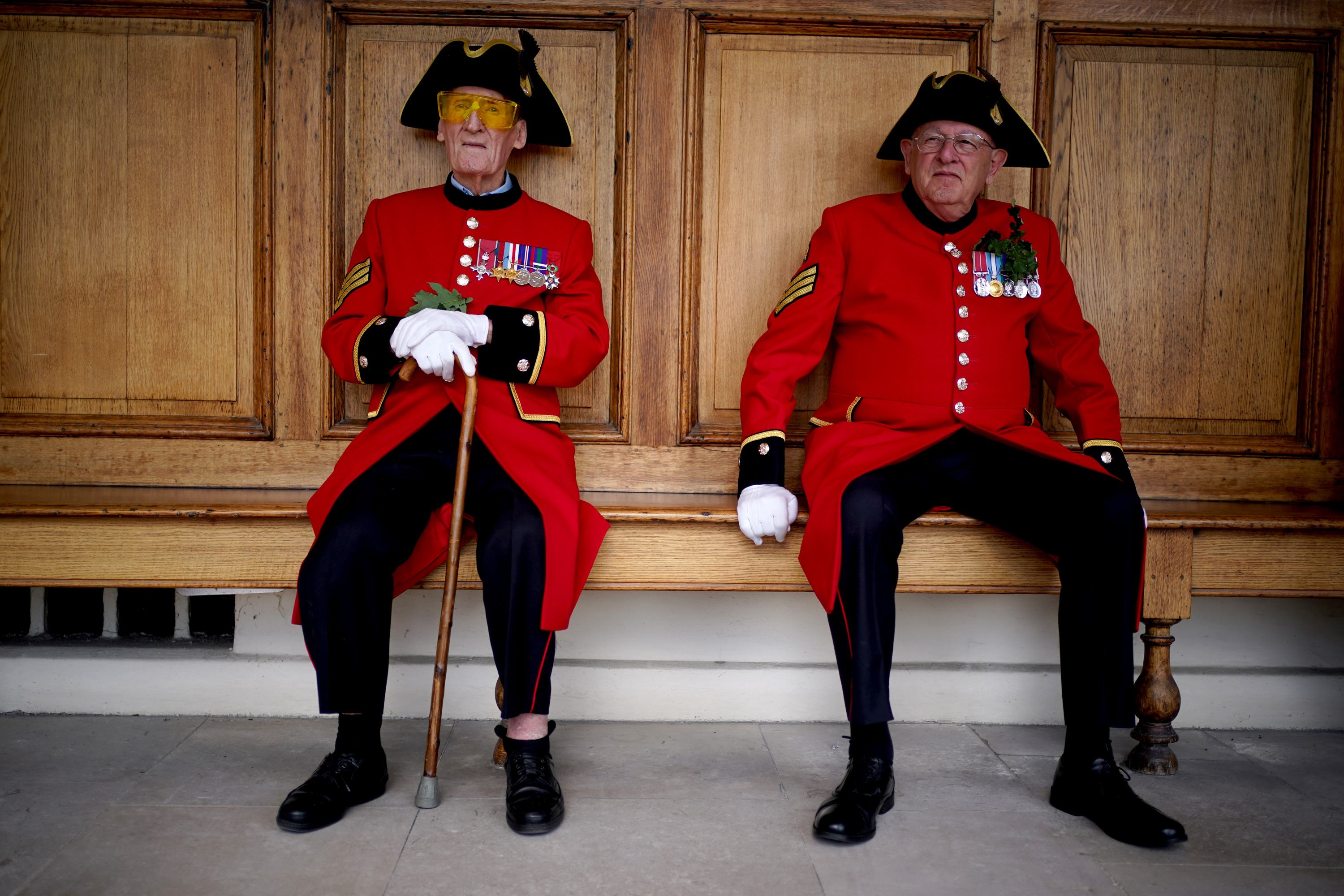 <p>Chelsea pensioner Bob Sullivan (left), 98, sits with a fellow veteran ahead of the annual Founder's Day Parade at the Royal Hospital Chelsea, London. Picture date: Thursday August 5, 2021.</p>