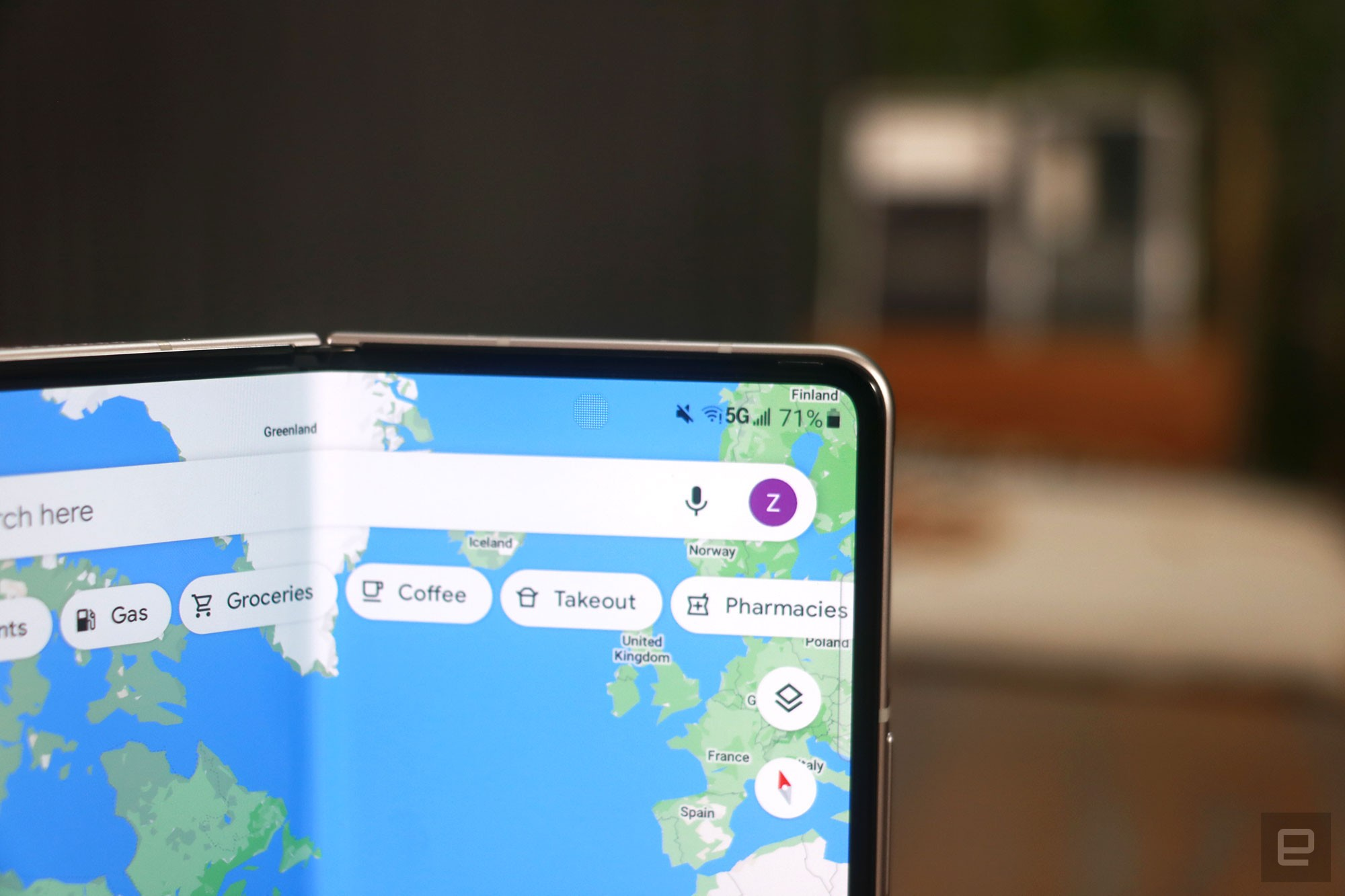 Galaxy Z Fold 3 close up on the under display camera with Google Maps open onscreen.