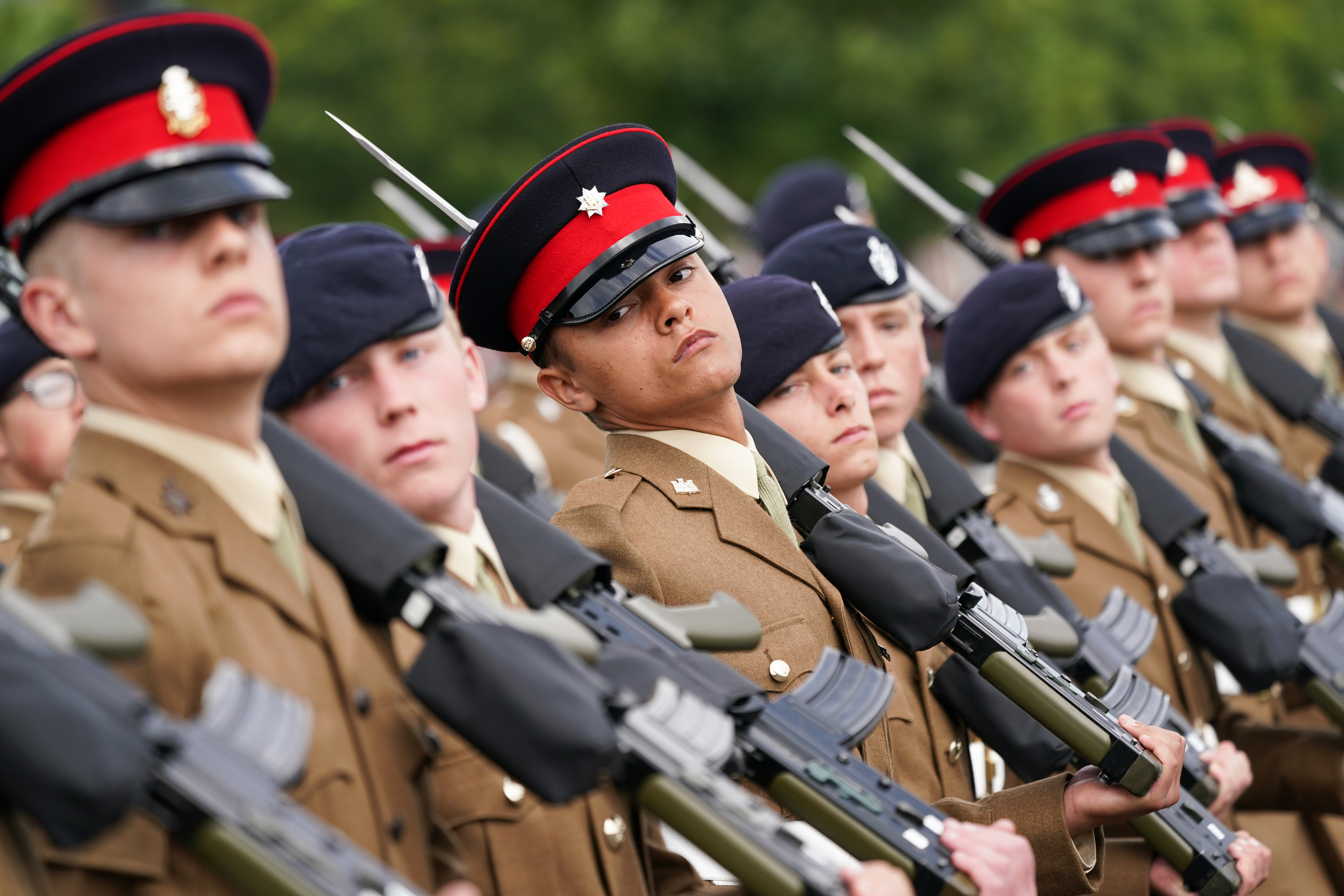 <p>HARROGATE, ENGLAND - AUGUST 05: Junior Soldiers from the Army Foundation College in Harrogate take part in their graduation parade on August 05, 2021 in Harrogate, England. The graduation parade marked the culmination up to 12 months of military training for over 700 of the British Army's newest future soldiers. Junior Soldiers from the Army Foundation College Harrogate completed initial soldier training that includes military skills, leadership training, physical development lessons, teamwork, and the Duke of Edinburgh's award. Family, friends and guests of the junior soldiers attended the parade, which was presided over by Lieutenant General Ian Cave CB, Commander Home Command and Standing Joint Commander (UK). The proceedings included a parachute display, fly past, music from a military band and the first use of Captain Sir Tom Moore Walk, a memorial walkway. (Photo by Ian Forsyth/Getty Images)</p>