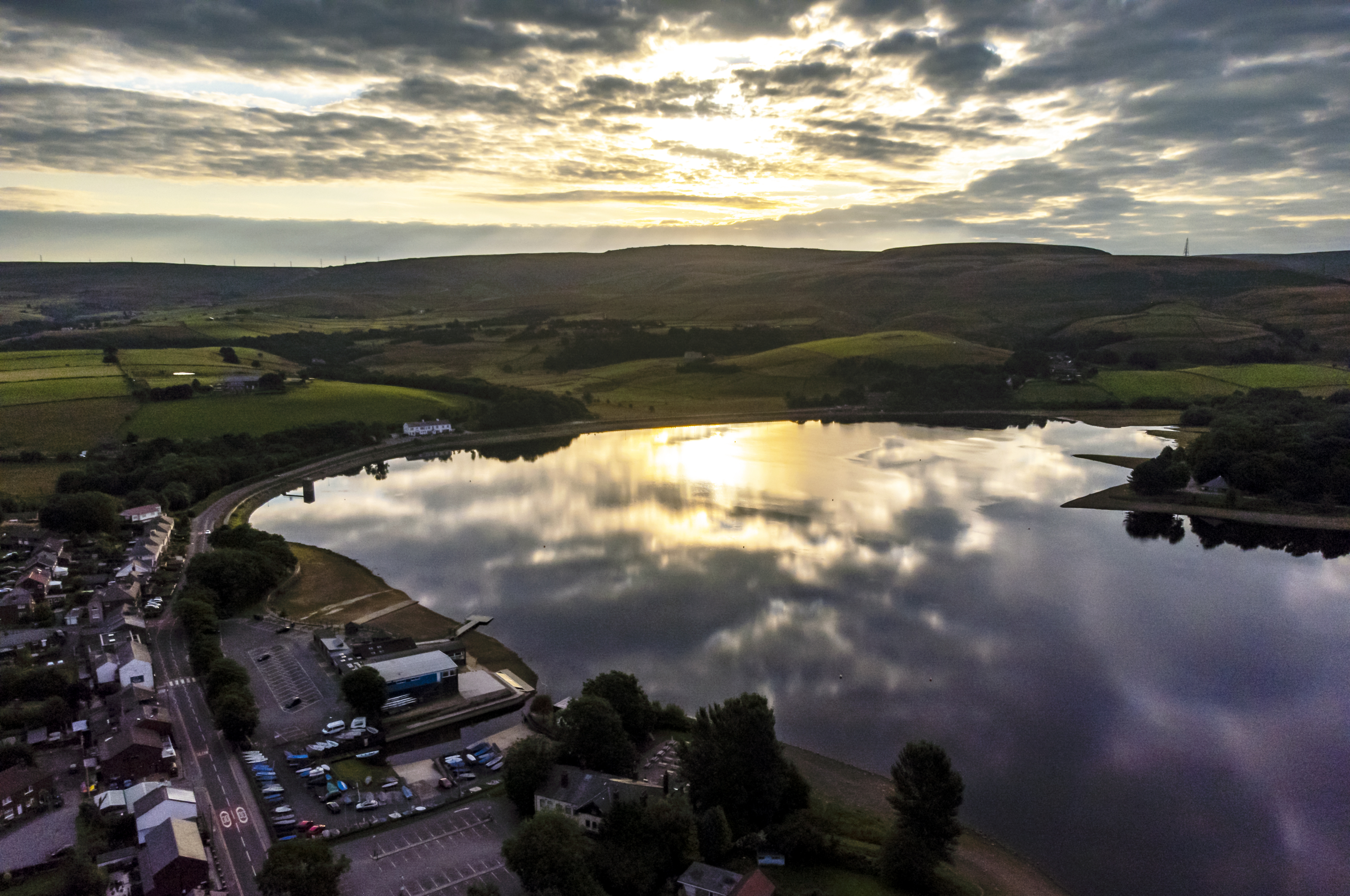 <p>The sun rises over Hollingworth Lake in Rochdale, Greater Manchester. Picture date: Sunday August 1, 2021.</p>