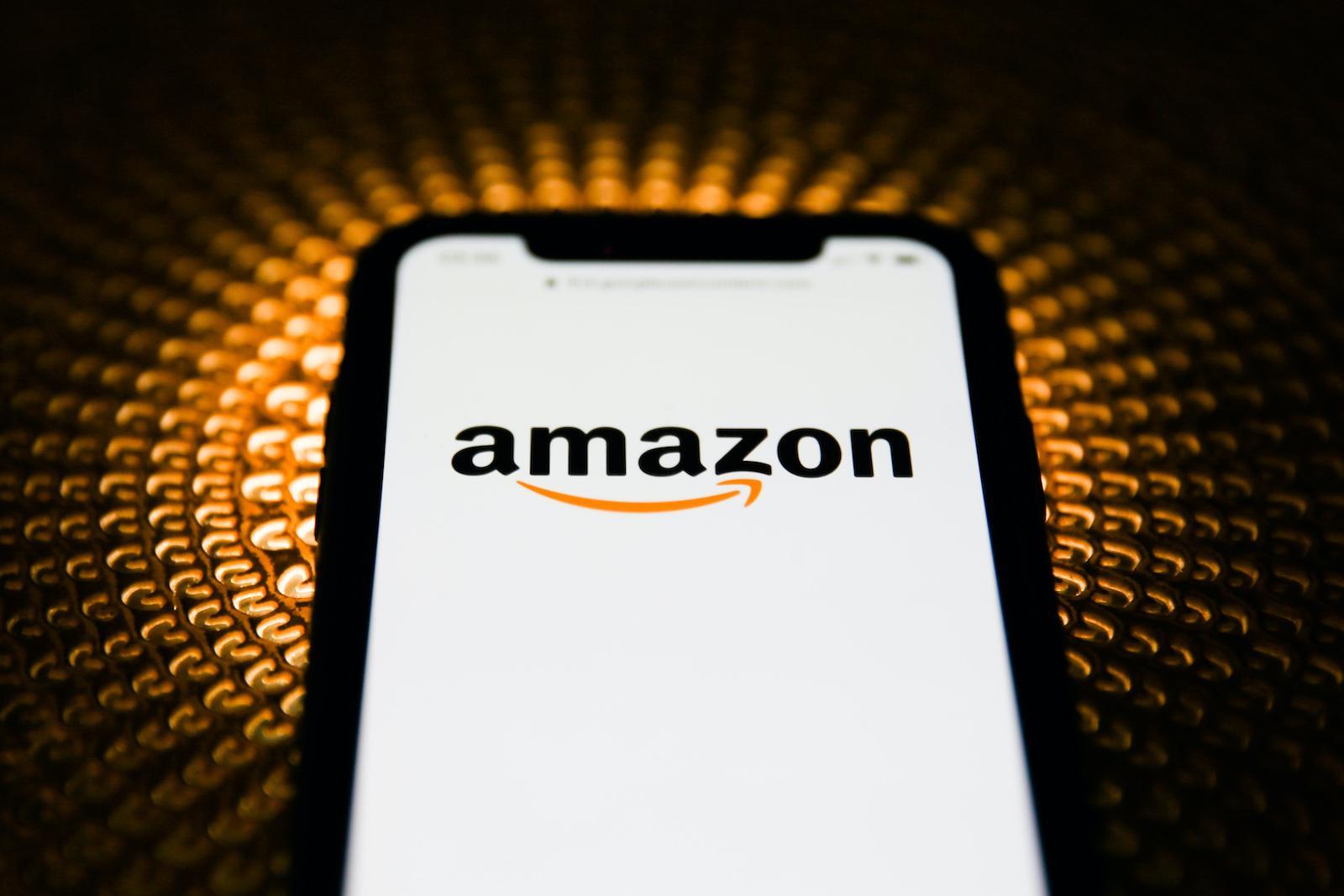 Amazon logo is seen displayed on phone screen in this illustration photo taken in Poland on February 20, 2020. (Photo illustration byJakub Porzycki/NurPhoto)