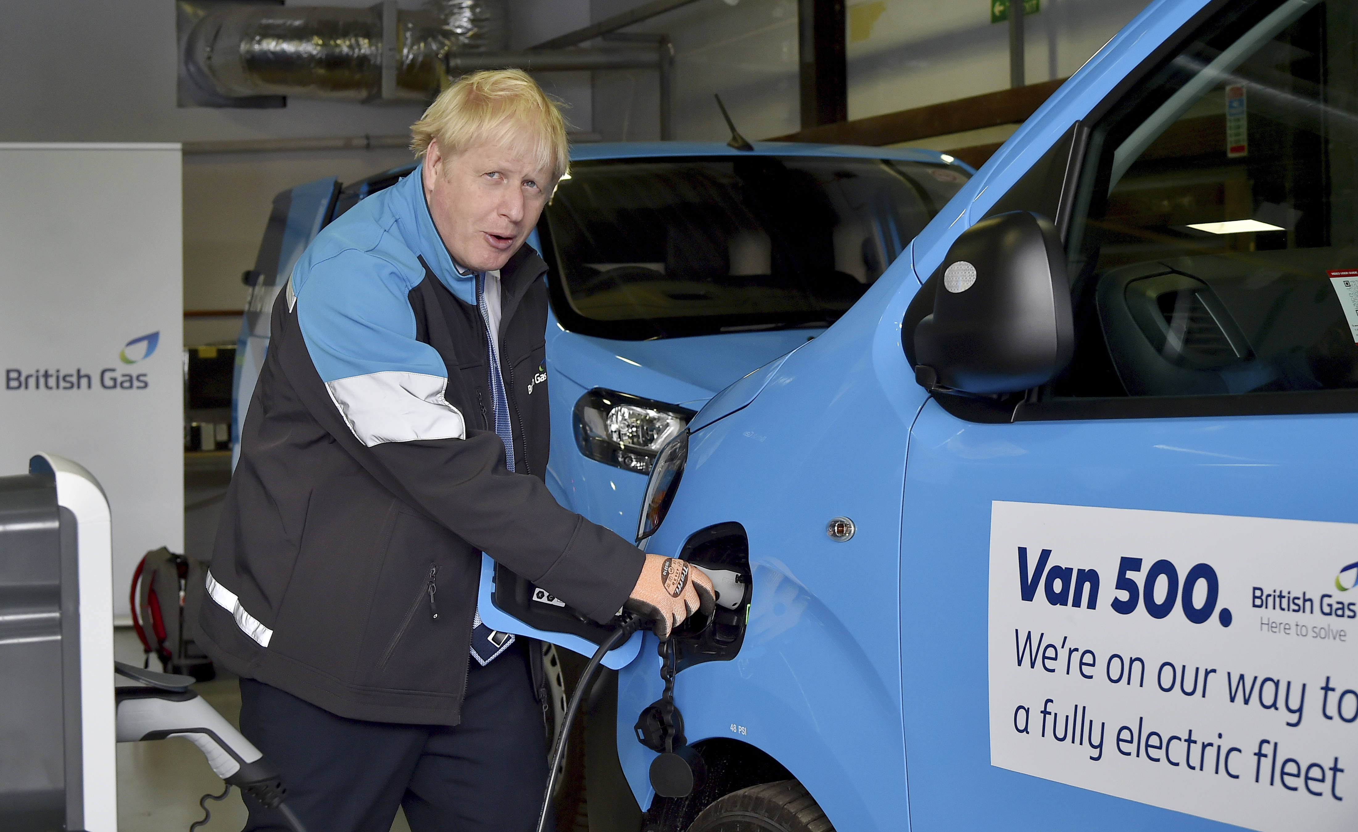 <p>Prime Minister Boris Johnson charges an electric van during a visit to a British Gas training academy in Leicestershire. Picture date: Monday September 13, 2021.</p>