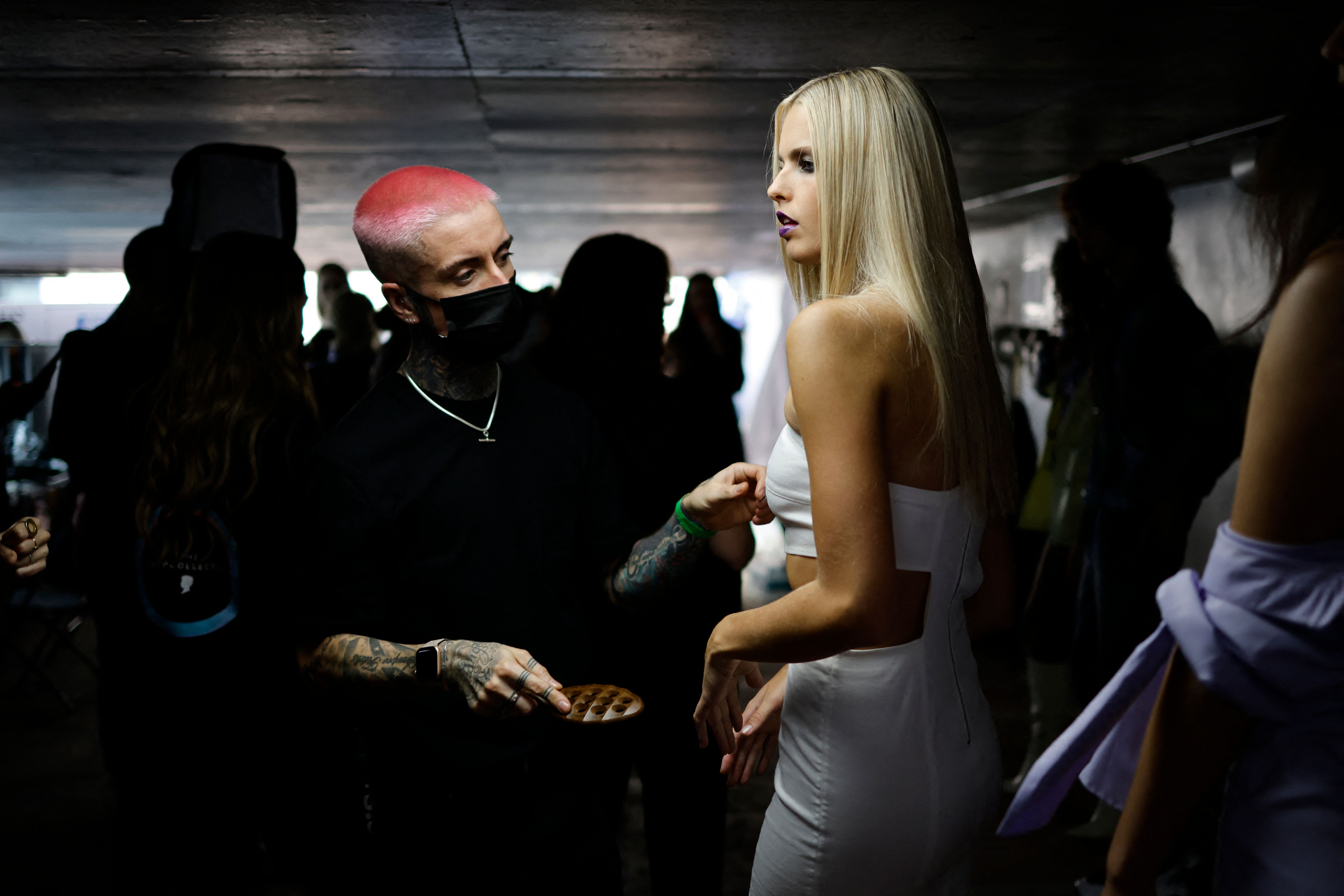 <p>A model is prepared backstage ahead of the catwalk show from British designer Mark Fast during a catwalk show for the Spring/Summer 2022 collection on the first day of London Fashion Week in London on September 17, 2021. (Photo by Tolga Akmen / AFP) (Photo by TOLGA AKMEN/AFP via Getty Images)</p>