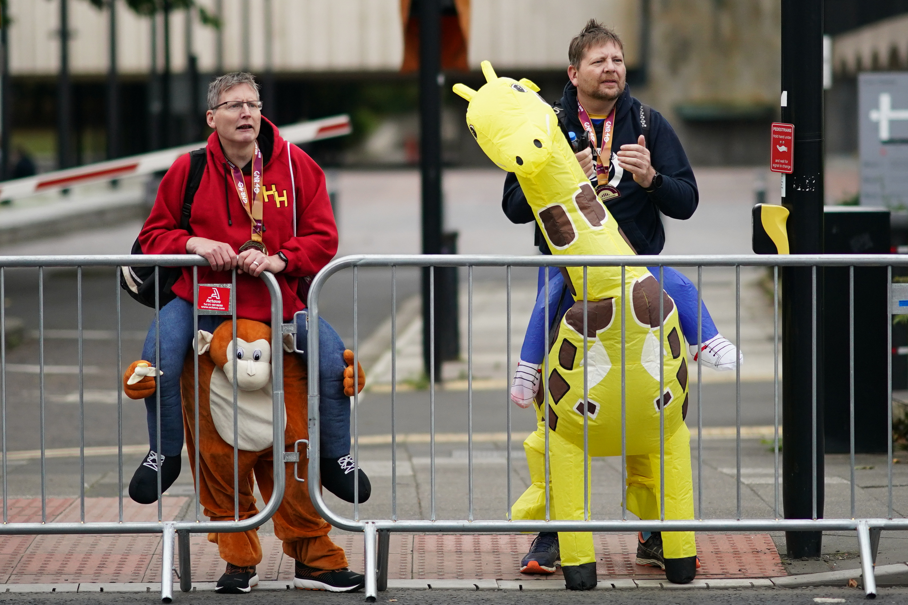 <p>NEWCASTLE UPON TYNE, ENGLAND - SEPTEMBER 12: Two runners in fancy dress support other runners as they run during the 40th Great North Run on September 12, 2021 in Newcastle upon Tyne, England. Approximately 57,000 runners are expected to take part in the marathon to raise money for a variety of different charities. The event, which was cancelled in 2020 due to the COVID-19 pandemic, is being held with several coronavirus safety measure in place, including route changes, staggered start times and hand sanitiser stations. (Photo by Ian Forsyth/Getty Images)</p>