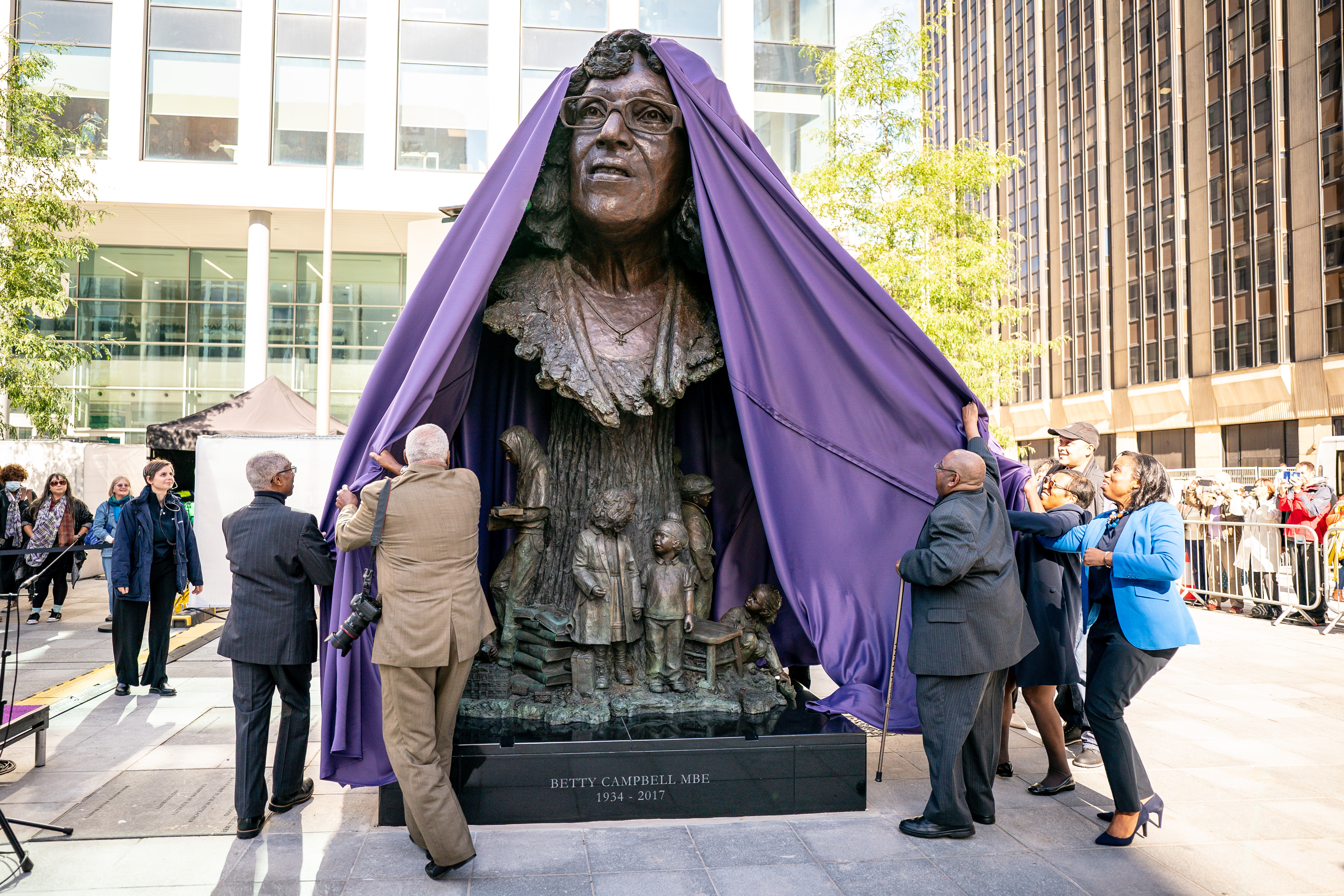 <p>The family of Betty Campbell unveil the bronze sculpture of her during the unveiling of the statue in Central Square, Cardiff, of Betty Campbell, Wales' first black headteacher. Picture date: Wednesday September 29, 2021.</p>